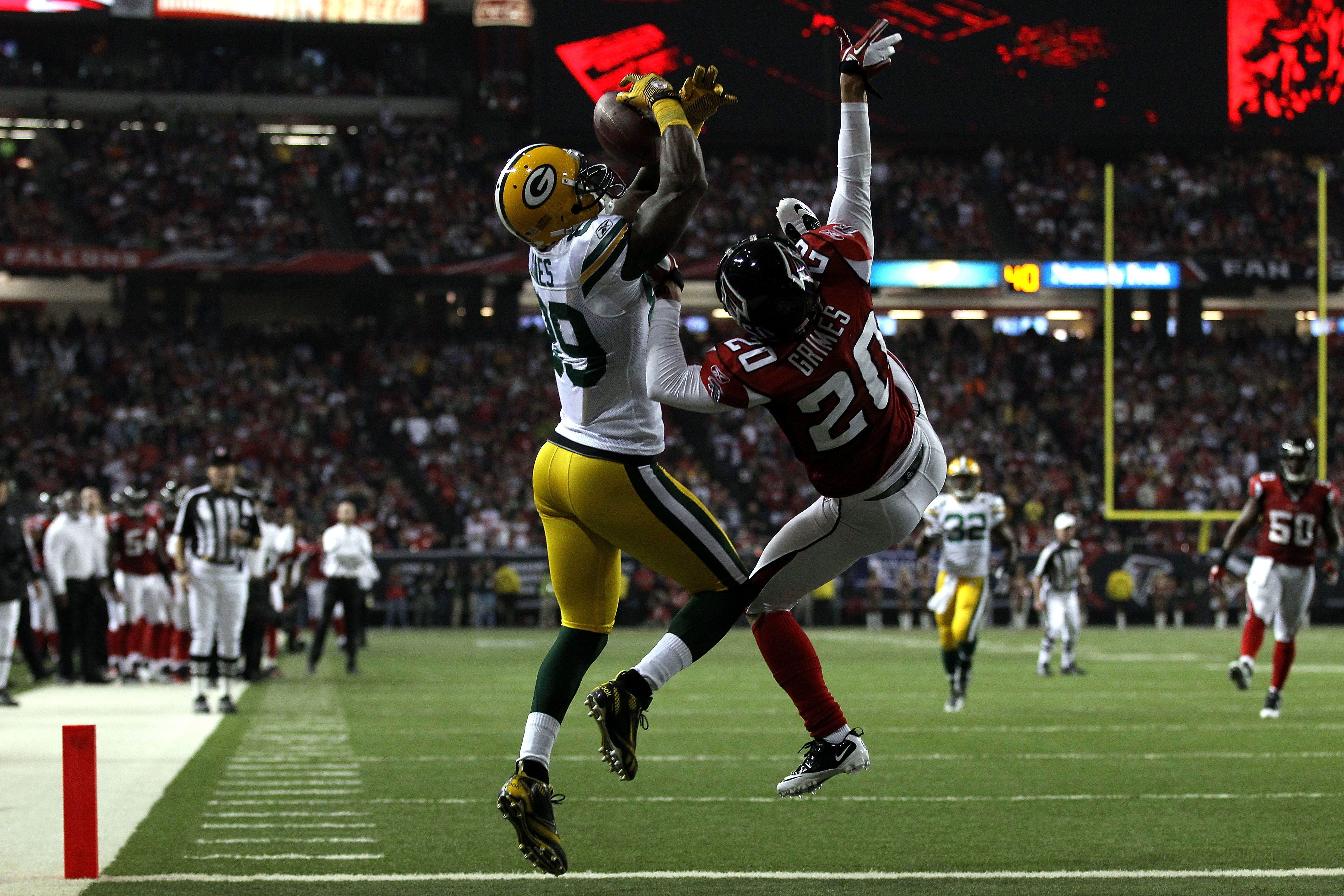 ATLANTA, GA - JANUARY 15:  James Jones #89 of the Green Bay Packers scores a 20-yard touchdown reception in the second quarter against Atari Bigby #20 of the Atlanta Falcons during their 2011 NFC divisional playoff game at Georgia Dome on January 15, 2011