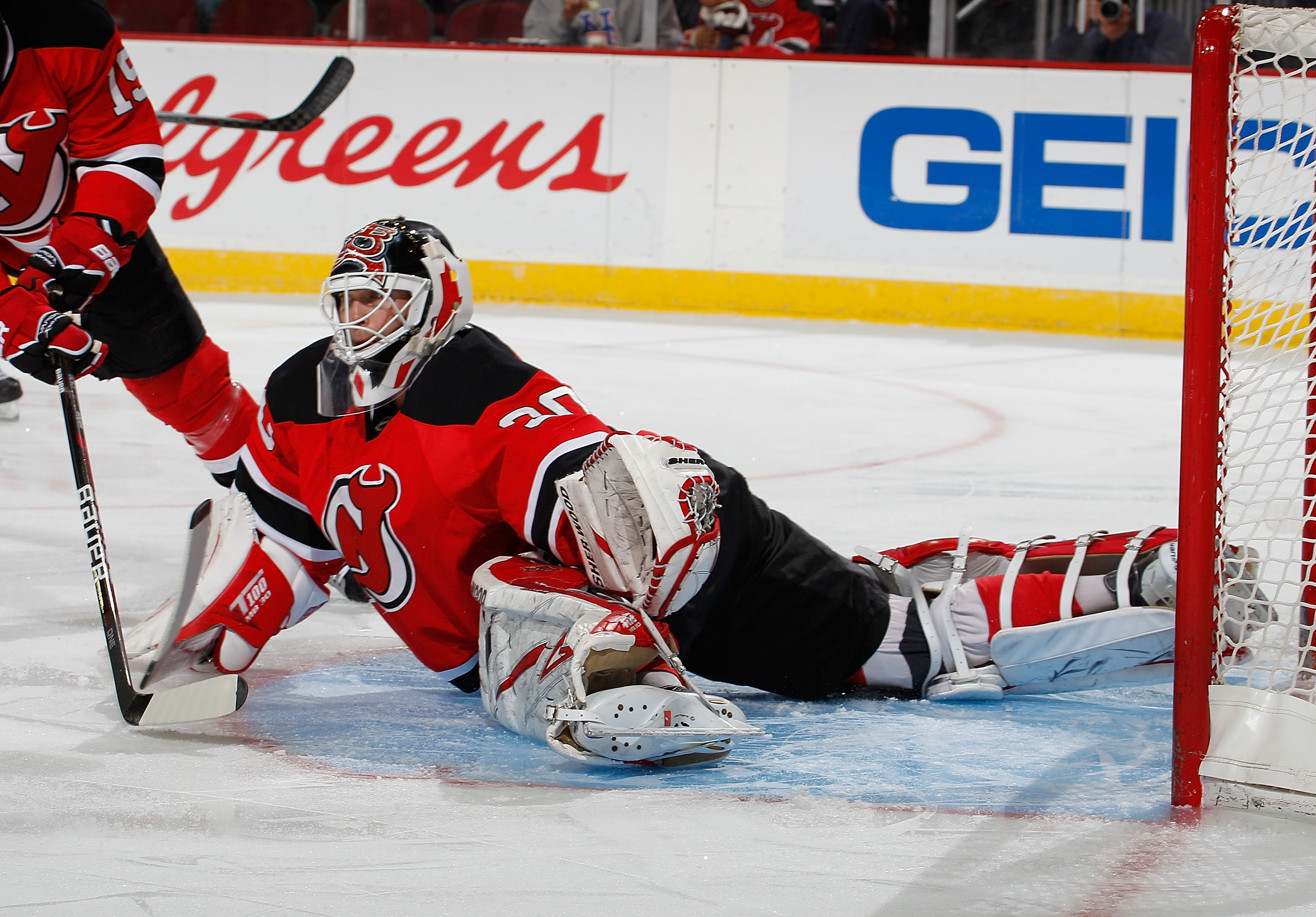 NEWARK, NJ - MARCH 02:  Martin Brodeur #30 of the New Jersey Devils makes a diving save during the first period of an NHL hockey game against the Tampa Bay Lightning at the Prudential Center on March 2, 2011 in Newark, New Jersey.  (Photo by Paul Bereswil