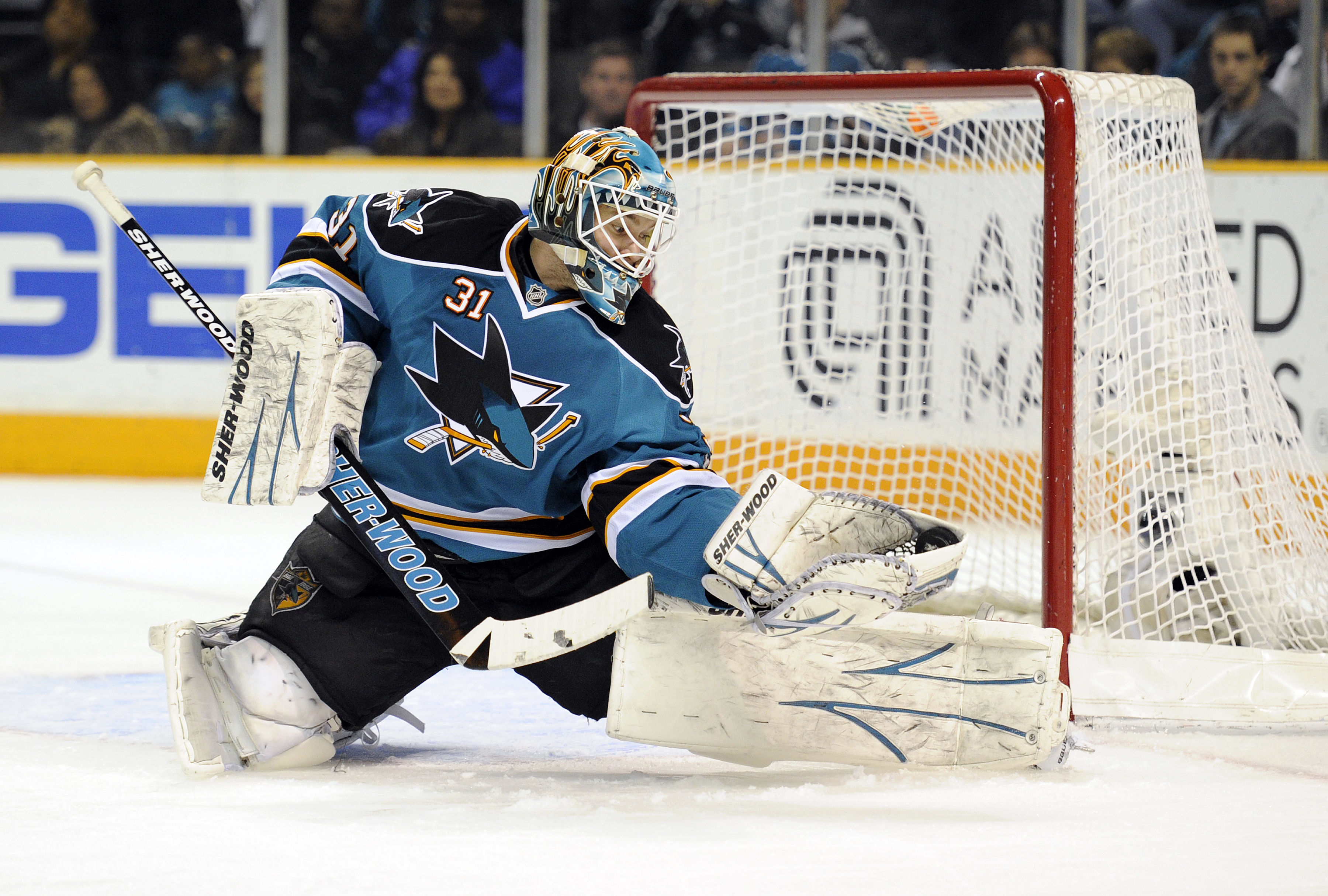 SAN JOSE, CA - MARCH 1: Antti Niemi #31 of the San Jose Sharks makes a glove hand save against the Colorado Avalanche in the first period during an NHL hockey game at the HP Pavilion on March 1, 2011 in San Jose, California. (Photo by Thearon W. Henderson