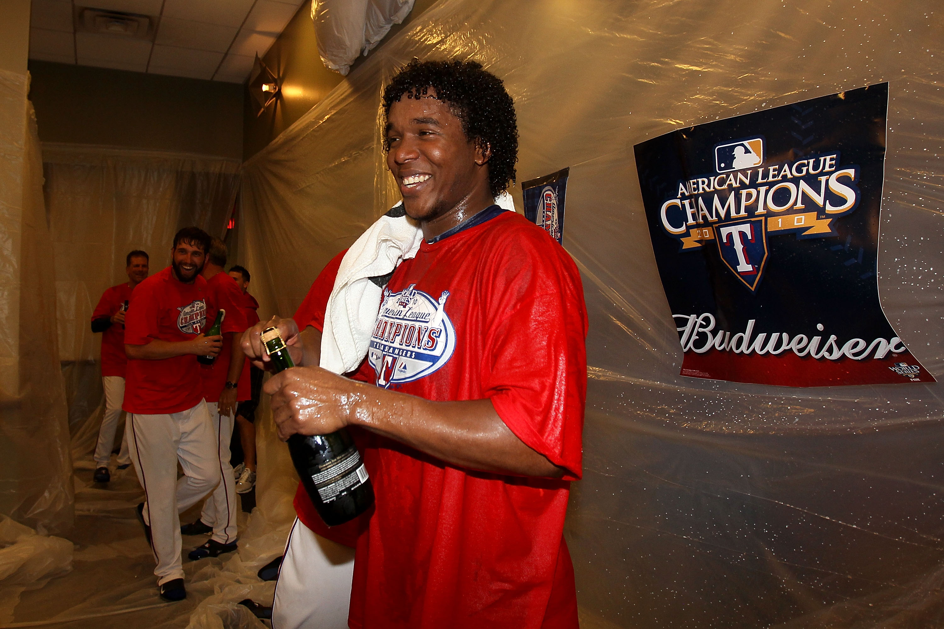 ARLINGTON, TX - OCTOBER 22:  Neftali Feliz #30 of the Texas Rangers sprays champagne in the lockerroom with after defeating the New York Yankees 6-1 in Game Six of the ALCS to advance to the World Series during the 2010 MLB Playoffs at Rangers Ballpark in