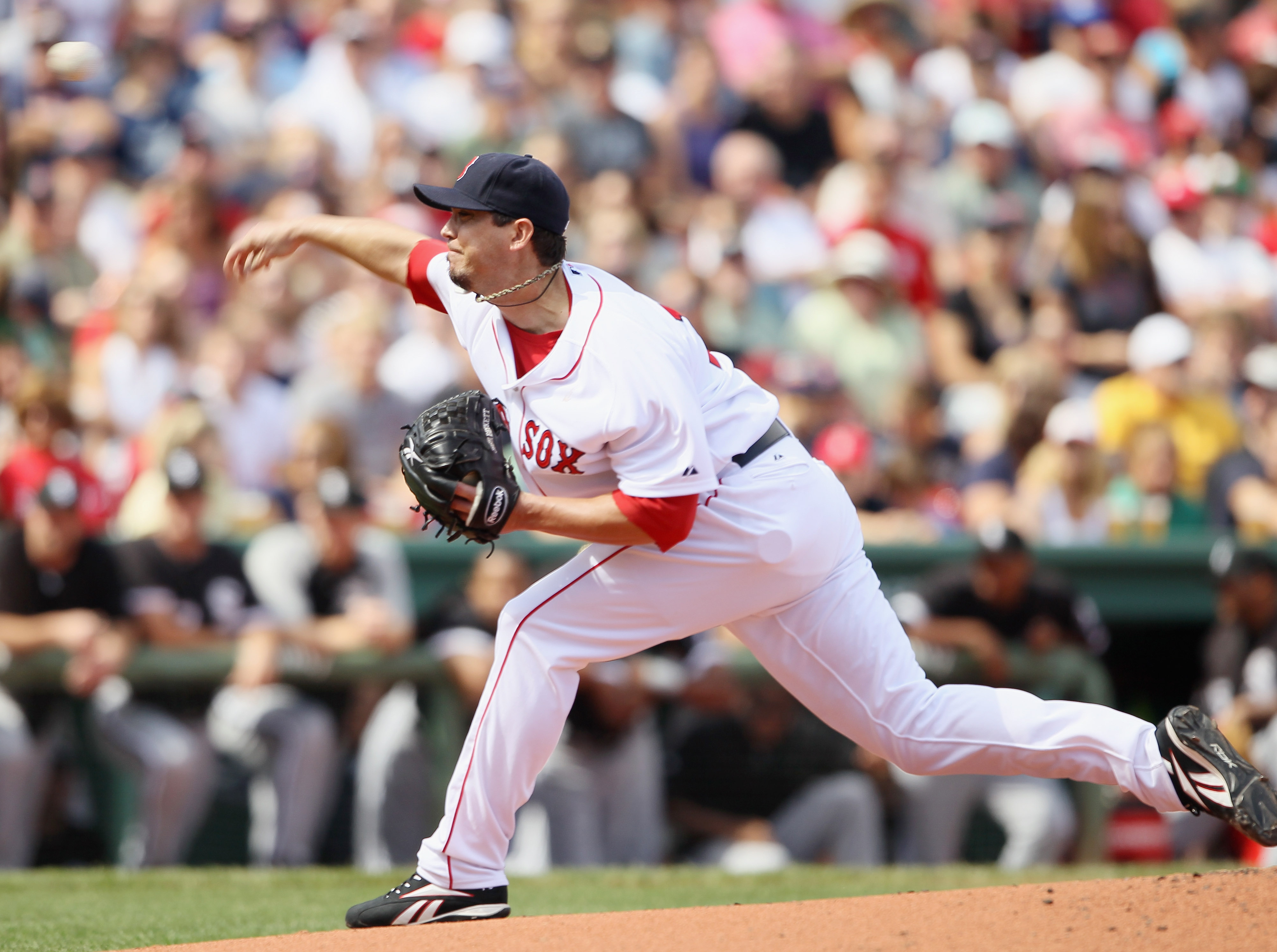 BOSTON - SEPTEMBER 05:  Josh Beckett #19 of the Boston Red Sox delivers a pitch in the first inning against the Chicago White Sox on September 5, 2010 at Fenway Park in Boston, Massachusetts.  (Photo by Elsa/Getty Images)