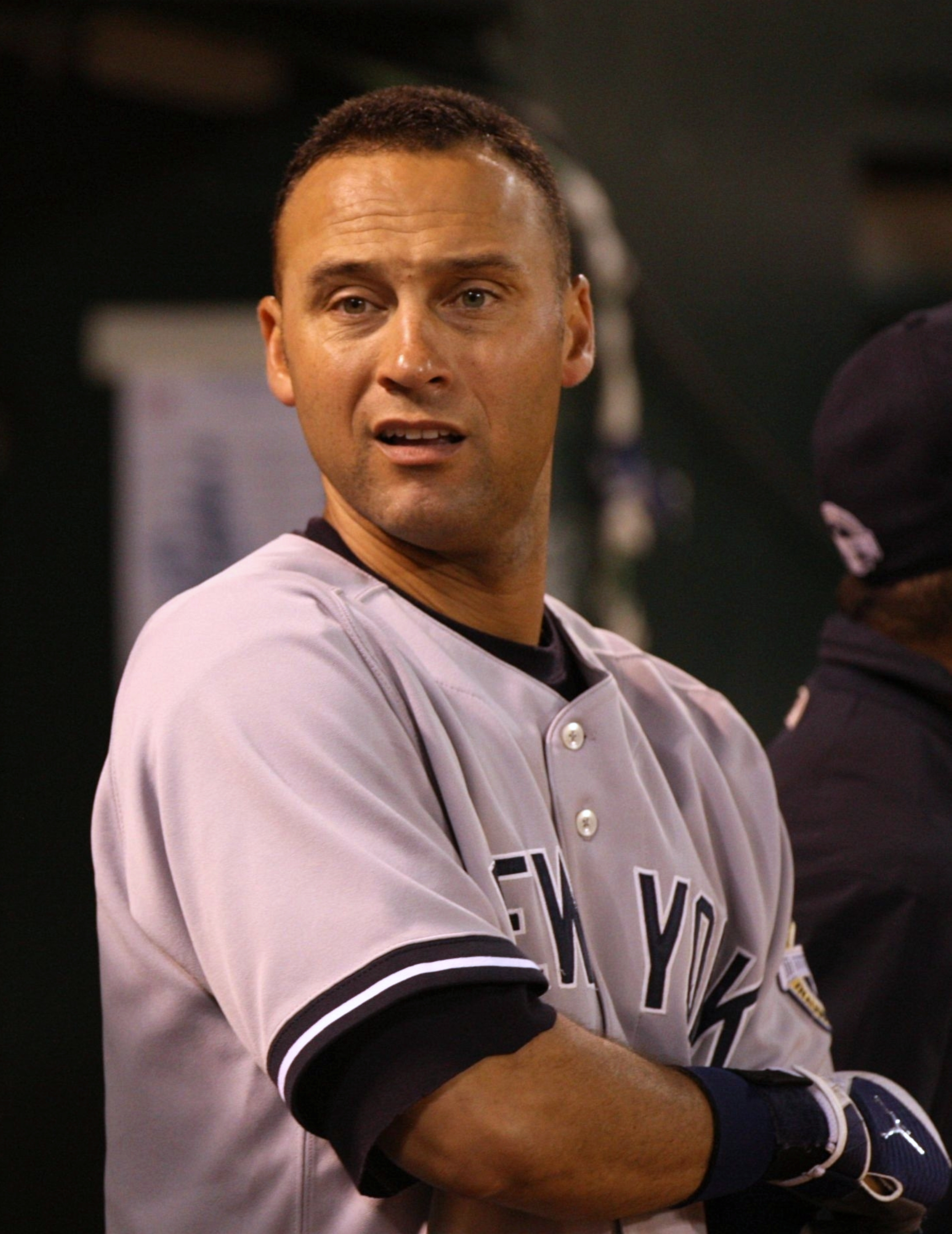 OAKLAND, CA - AUGUST 17:  Derek Jeter #2 of the New York Yankees looks on dejected from the dugout in the ninth inning against the Oakland Athletics during the Major League Baseball game at the Oakland Coliseum on August 17, 2009 in Oakland, California. (