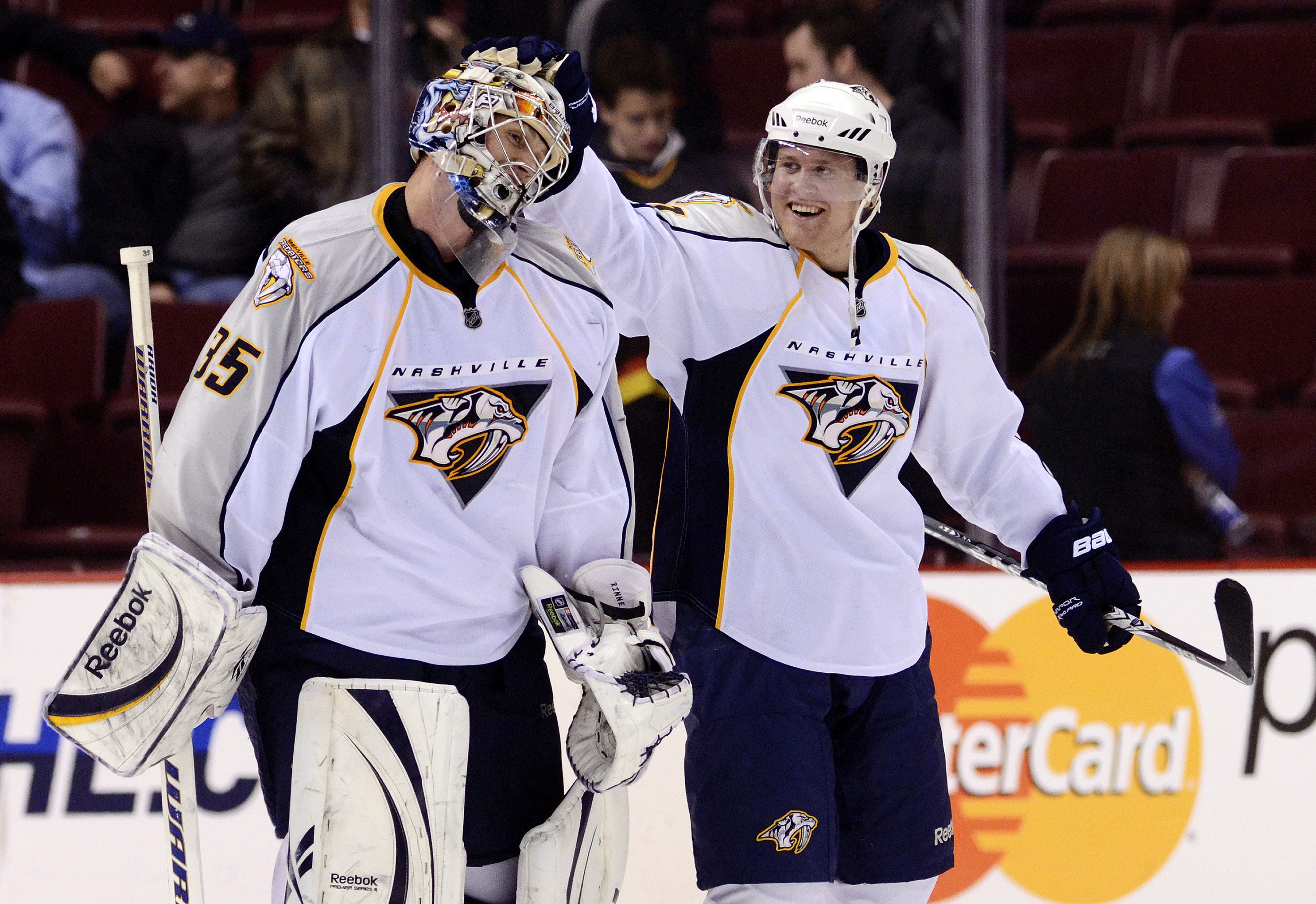VANCOUVER, CANADA - MARCH 3: Goalie Pekka Rinne #35 of the Nashville Predators is congratulated by Patric Hornqvist #27 after defeating the Vancouver Canucks 3-0 in NHL action on March 03, 2011 at Rogers Arena in Vancouver, British Columbia, Canada.  (Pho