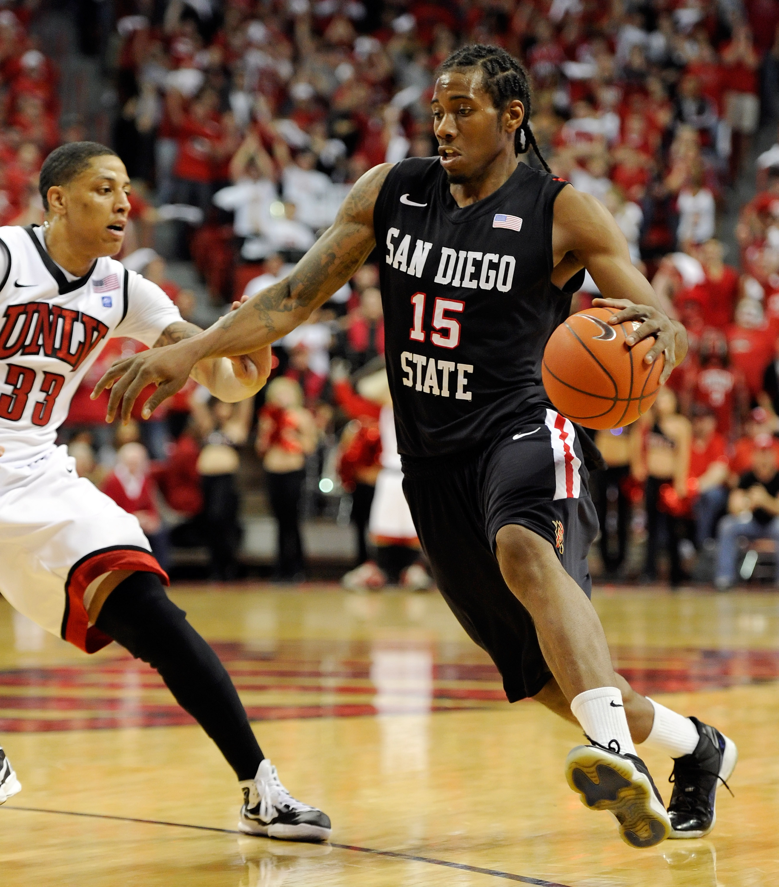 LAS VEGAS, NV - FEBRUARY 12:  Kawhi Leonard #15 of the San Diego State Aztecs drives against Tre'Von Willis #33 of the UNLV Rebels during their game at the Thomas & Mack Center February 12, 2011 in Las Vegas, Nevada. San Diego State won 63-57.  (Photo by