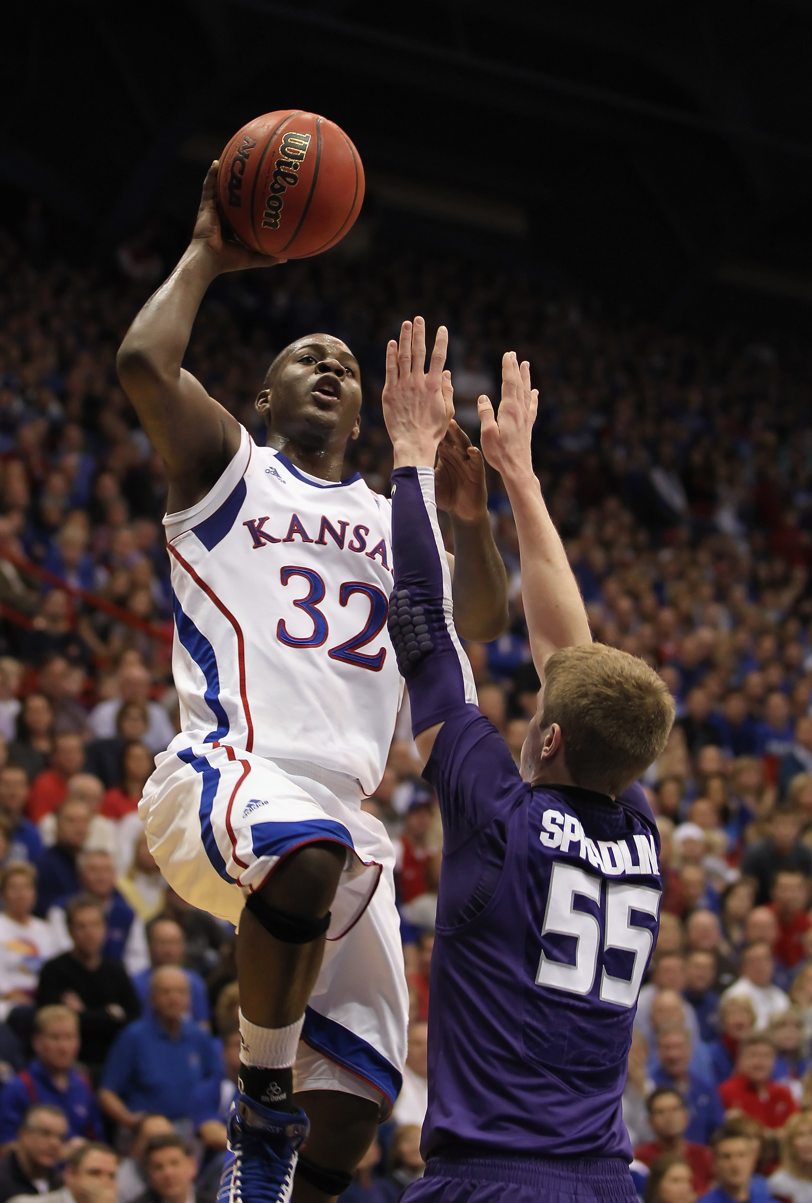 LAWRENCE, KS - JANUARY 29:  Josh Selby #32 of the Kansas Jayhawks shoots over Will Spradling #55 of the Kansas State Wildcats for a rebound during the game on January 29, 2011 at Allen Fieldhouse in Lawrence, Kansas.  (Photo by Jamie Squire/Getty Images)