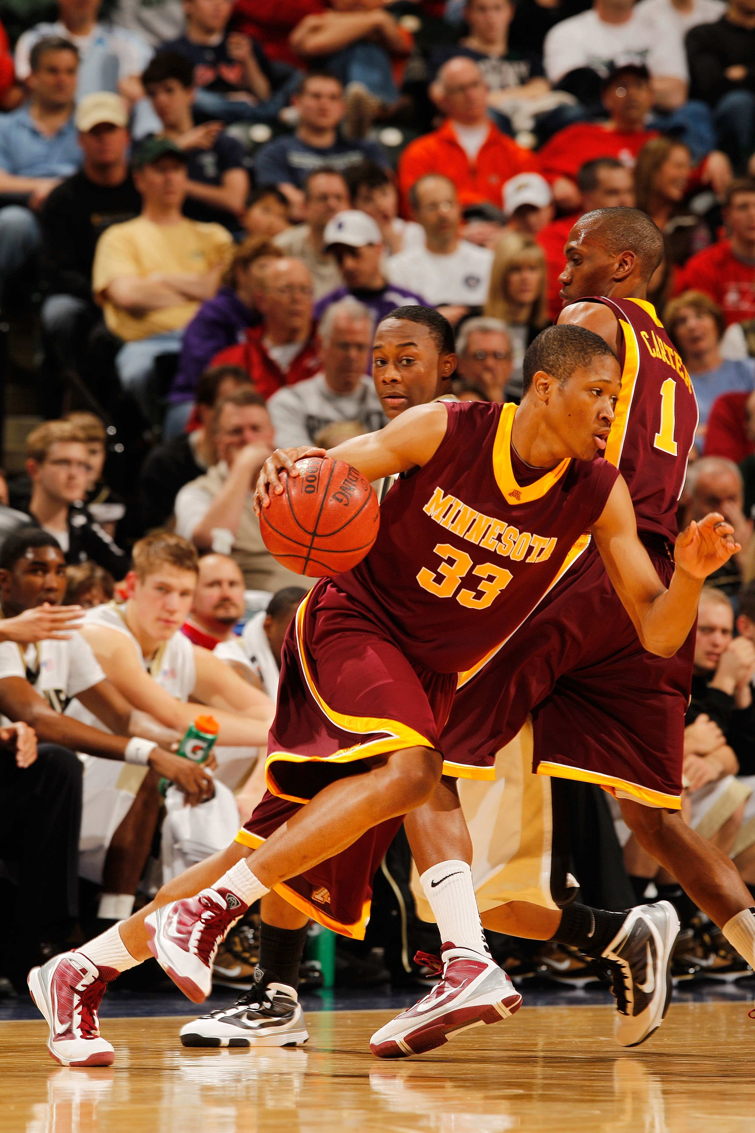 INDIANAPOLIS - MARCH 13:  Forward Rodney Williams #33 of the Minnesota Golden Gophers drives against the Purdue Boilermakers in the semifinals of the Big Ten Men's Basketball Tournament at Conseco Fieldhouse on March 13, 2010 in Indianapolis, Indiana.  (P