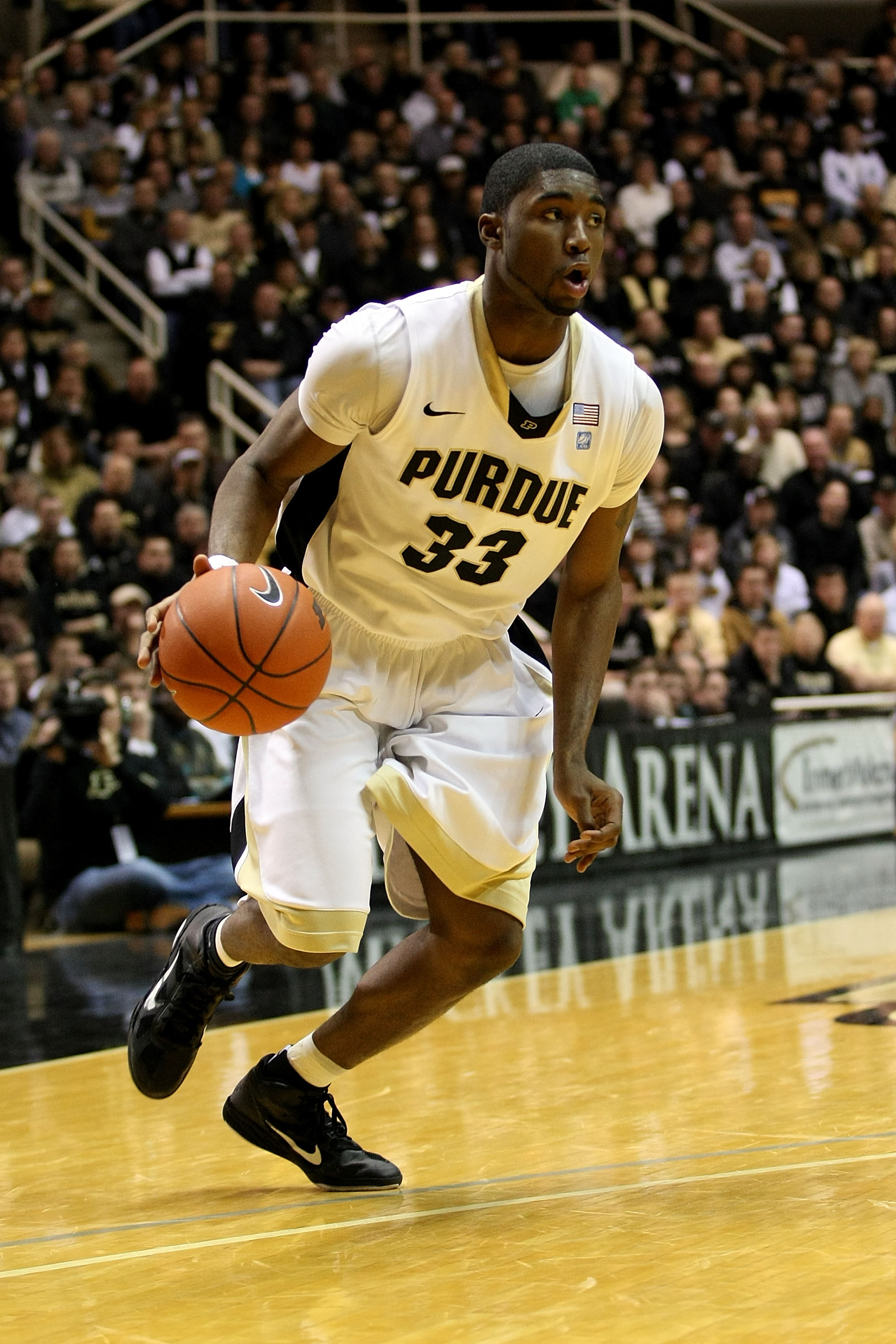 WEST LAFAYETTE, IN - JANUARY 09:  E'Twaun Moore #33 of the Purdue Boilermakers drives against the Iowa Hawkeyes at Mackey Arena on January 9, 2011 in West Lafayette, Indiana. Purdue won 75-52. (Photo by Chris Chambers/Getty Images)