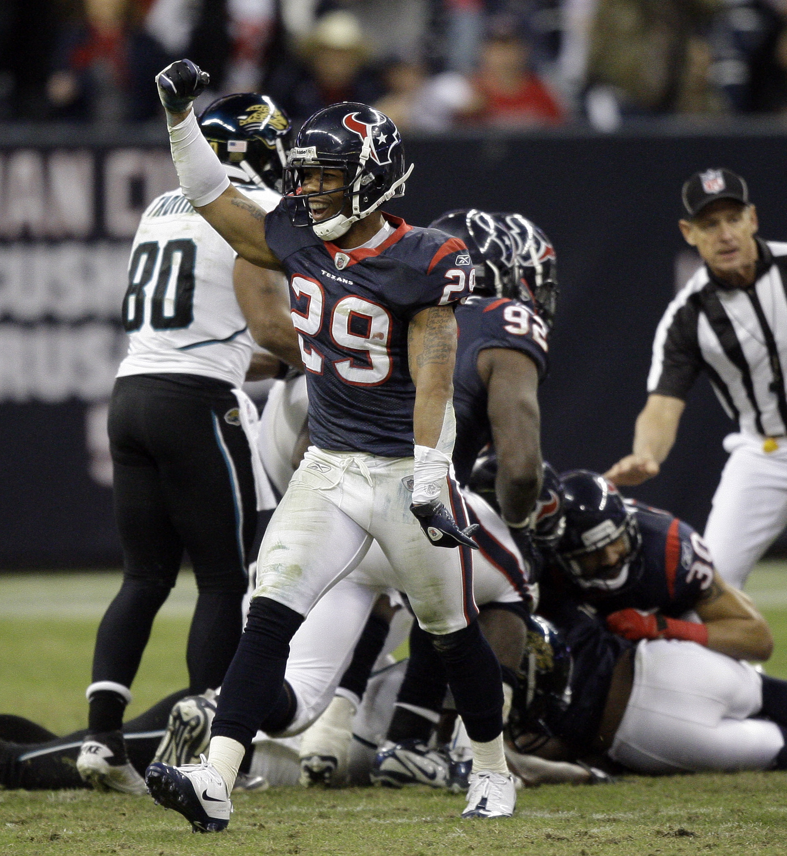 HOUSTON - JANUARY 02:  Glover Quin #29 of the Houston Texans celebrates after recovering a fumble late in the fourth quarter against the Jacksonville Jaguars at Reliant Stadium on January 2, 2011 in Houston, Texas.  (Photo by Bob Levey/Getty Images)