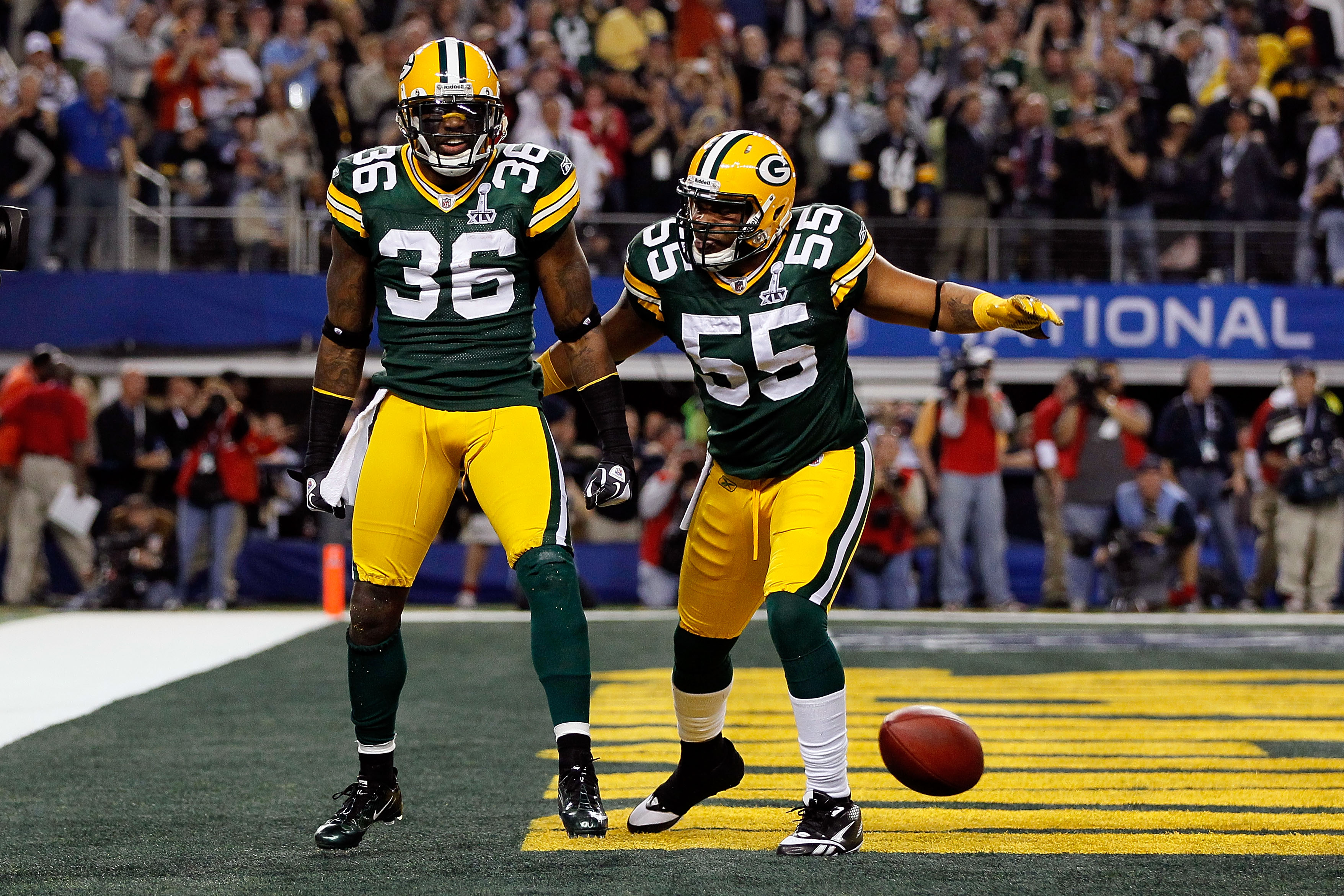 ARLINGTON, TX - FEBRUARY 06:  (L-R) Nick Collins #36 and Desmond Bishop #55 of the Green Bay Packers celebrate after Collins scored a touchdown on an interception return against the Pittsburgh Steelers during Super Bowl XLV at Cowboys Stadium on February