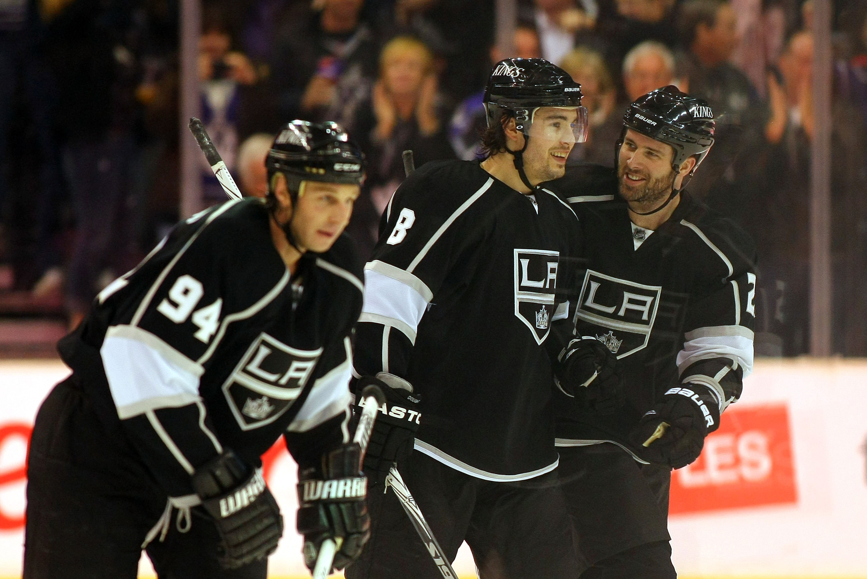 LOS ANGELES, CA - MARCH 03:  Ryan Smyth #94, Drew Doughty #8 and Dustin Penner #25 of the Los Angeles Kings skate back to the bench after celebrating a goal by teammate Jarret Stoll #28 (not in photo) against the Phoenix Coyotes in the third period during