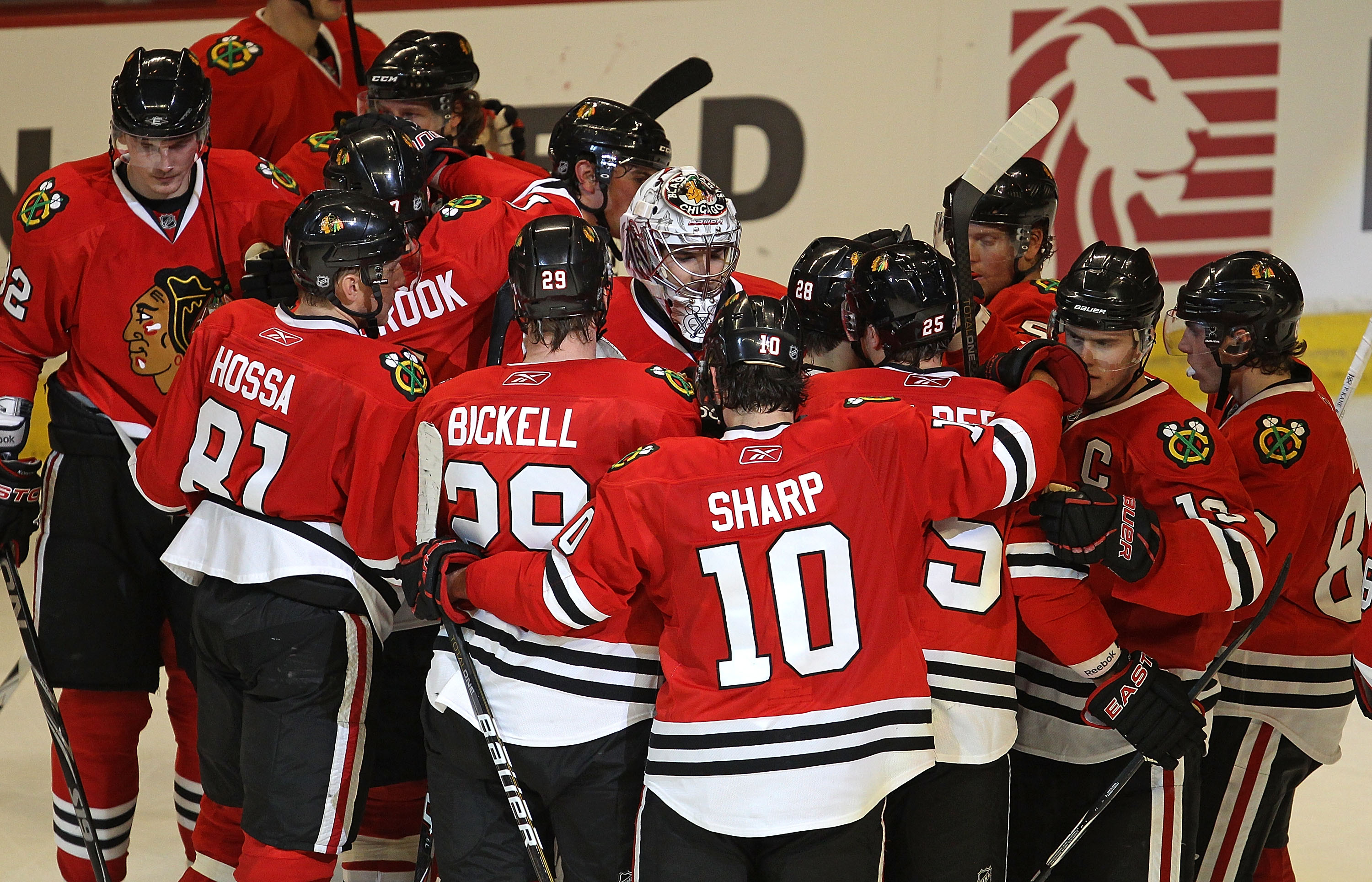 CHICAGO, IL - FEBRUARY 27: Corey Crawford #50 of the Chicago Blackhawks (center with mask) is surrounded by teammates including Marian Hossa #81, Bryan Bickell #29 and Patrick Sharp #10 after a win over the Phoenix Coyotes at the United Center on February