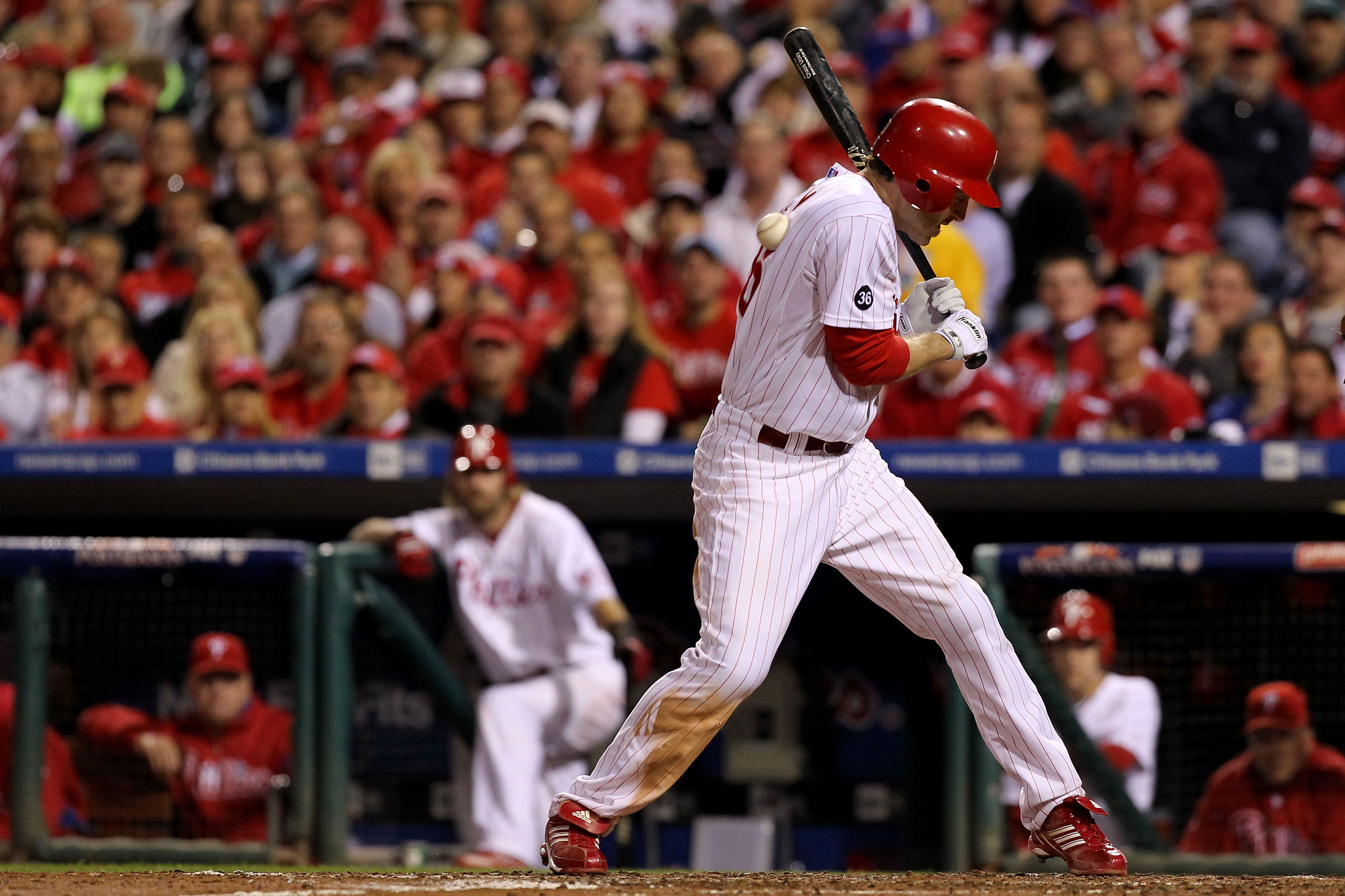 PHILADELPHIA - OCTOBER 23:  Chase Utley #26 of the Philadelphia Phillies is hit by a pitch in the third inning against the San Francisco Giants in Game Six of the NLCS during the 2010 MLB Playoffs at Citizens Bank Park on October 23, 2010 in Philadelphia,