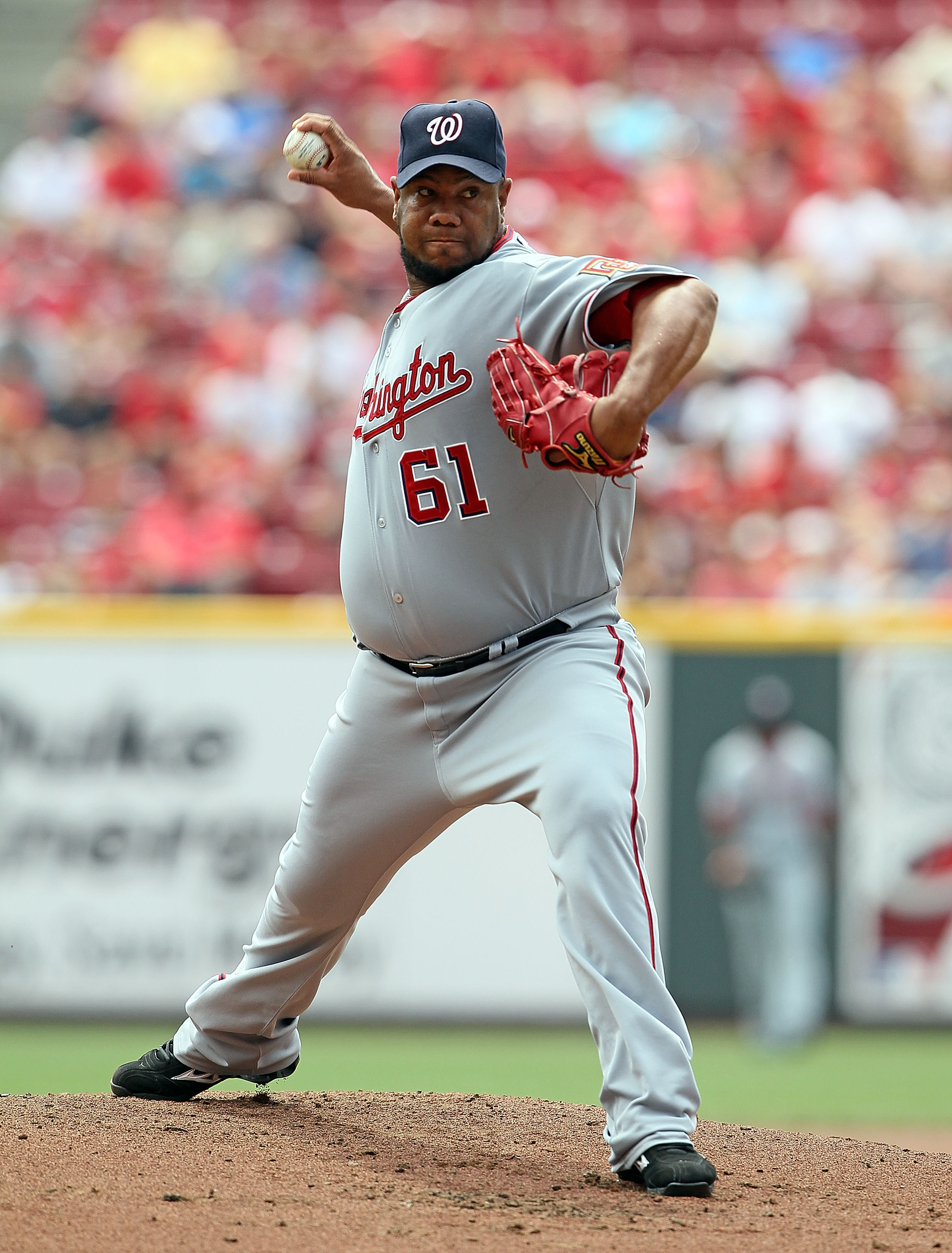 CINCINNATI - JULY 22:  Livan Hernandez #61 of the Washington Nationals throws a pitch during the game against the Cincinnati Reds at Great American Ball Park on July 22, 2010 in Cincinnati, Ohio.  (Photo by Andy Lyons/Getty Images)