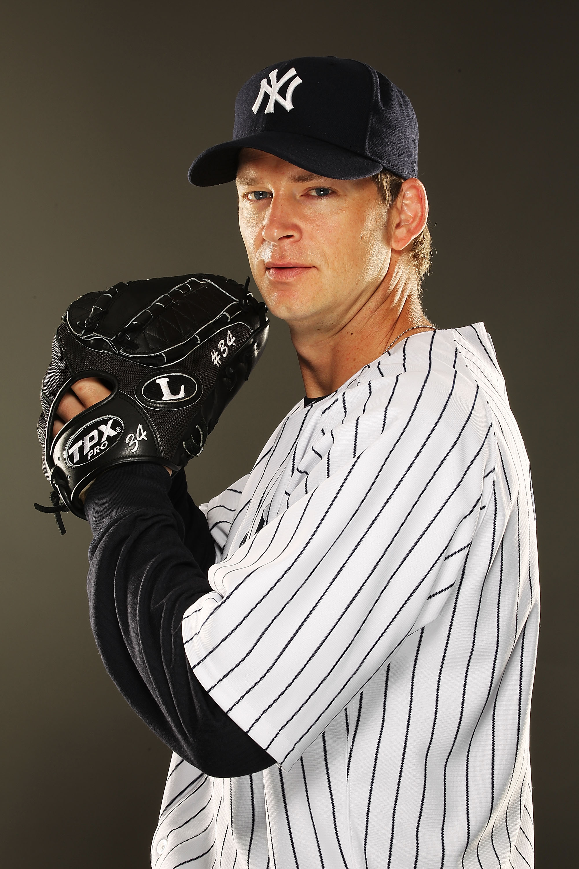 TAMPA, FL - FEBRUARY 23:  A.J. Burnett #34 of the New York Yankees poses for a portrait on Photo Day at George M. Steinbrenner Field on February 23, 2011 in Tampa, Florida.  (Photo by Al Bello/Getty Images)
