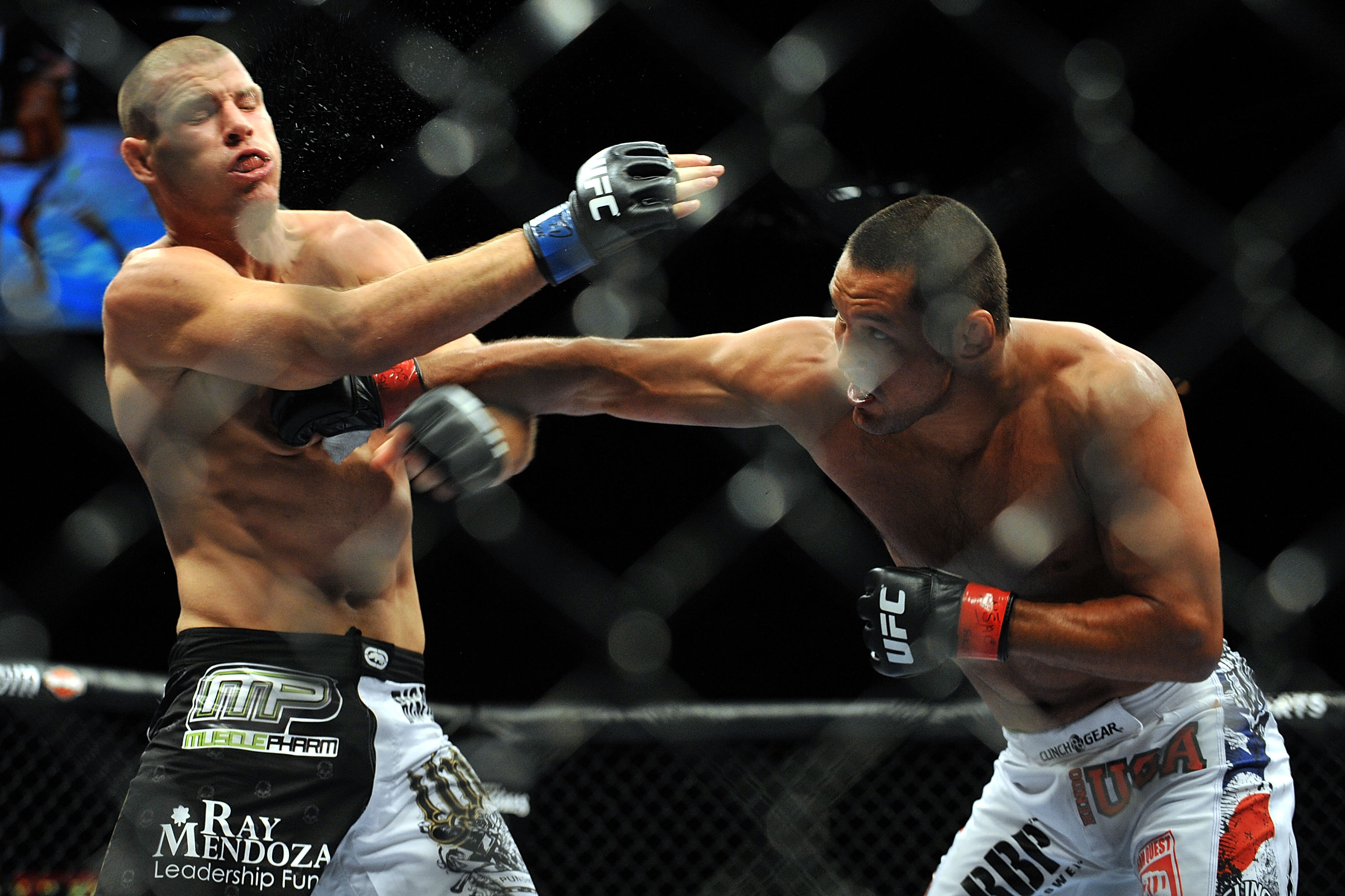 LAS VEGAS - JULY 11:  (R-L) Dan Henderson connects with a right to Mike Bisping during their middleweight bout during UFC 100 on July 11, 2009 in Las Vegas, Nevada.  (Photo by Jon Kopaloff/Getty Images)