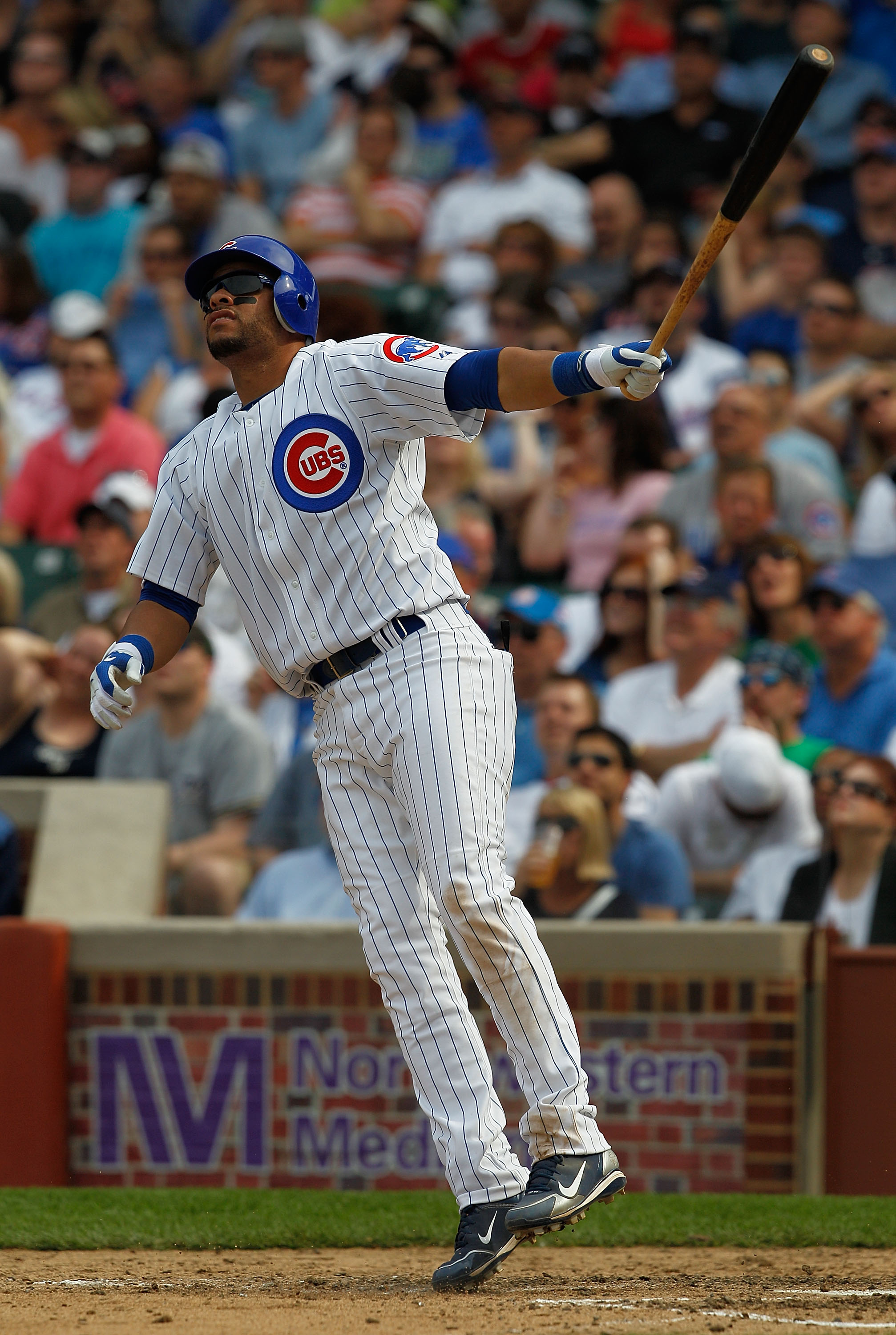 CHICAGO - APRIL 15: Aramis Ramirez of the Chicago Cubs, wearing a number 42 jersey in honor of Jackie Robinson, hops after hitting a home run against the Milwaukee Brewers in the 6th inning at Wrigley Field on April 15, 2010 in Chicago, Illinois. (Photo b