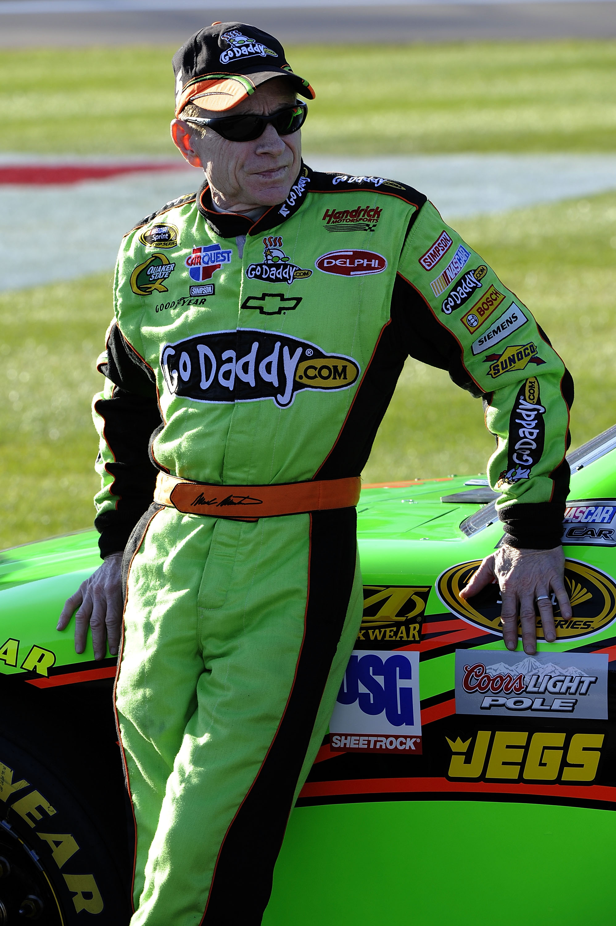 LAS VEGAS, NV - MARCH 04:  Mark Martin, driver of the #5 GoDaddy.com Chevrolet, leans on his car during qualifying for the NASCAR Sprint Cup Series Kobalt Tools 400 at Las Vegas Motor Speedway on March 4, 2011 in Las Vegas, Nevada.  (Photo by John Harrels