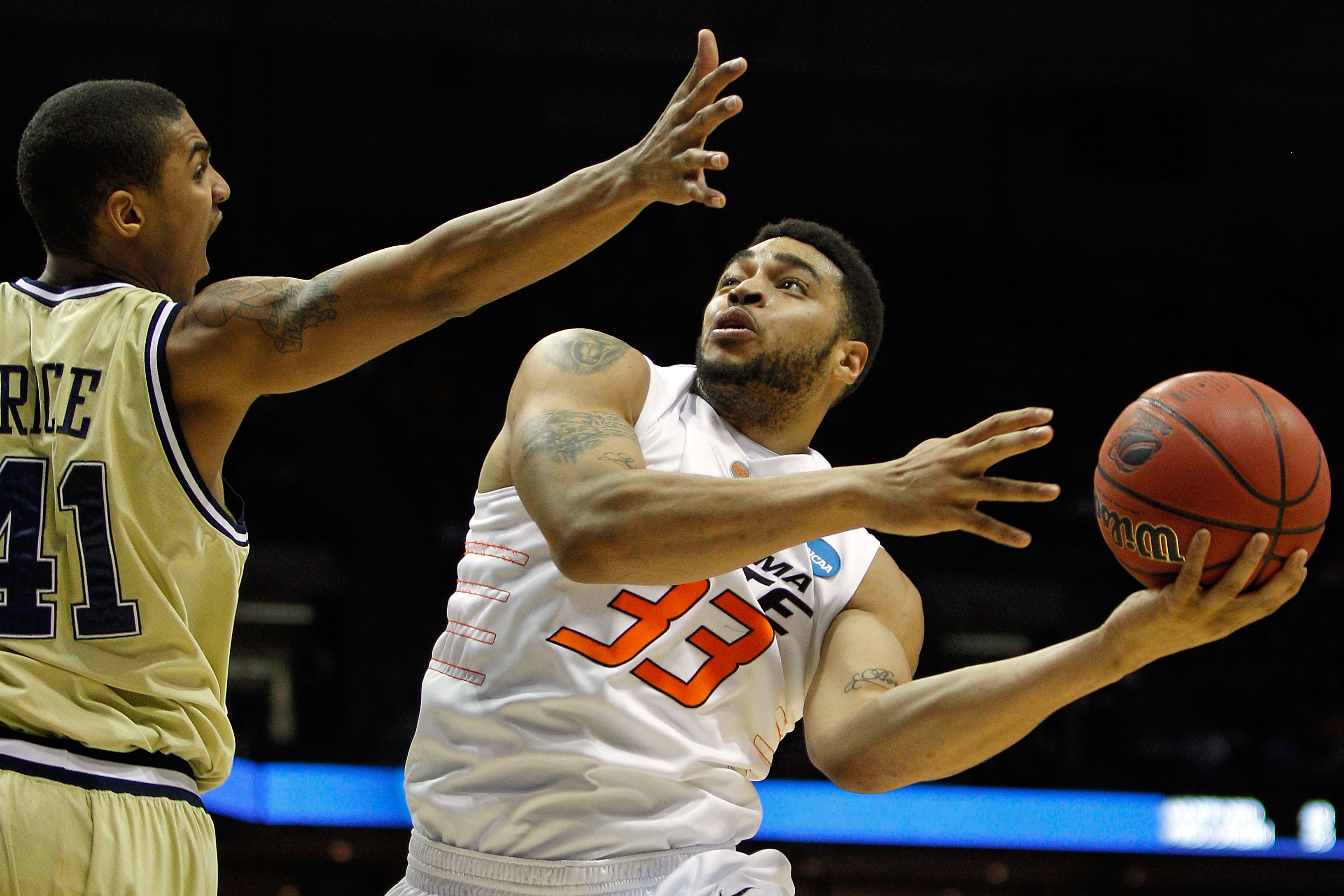 MILWAUKEE - MARCH 19:  Marshall Moses #33 of the Oklahoma State Cowboys goes up for a shot against Glen Rice Jr. #41 of the Georgia Tech Yellow Jackets in the first half during the first round of the 2010 NCAA men's basketball tournament at the Bradley Ce