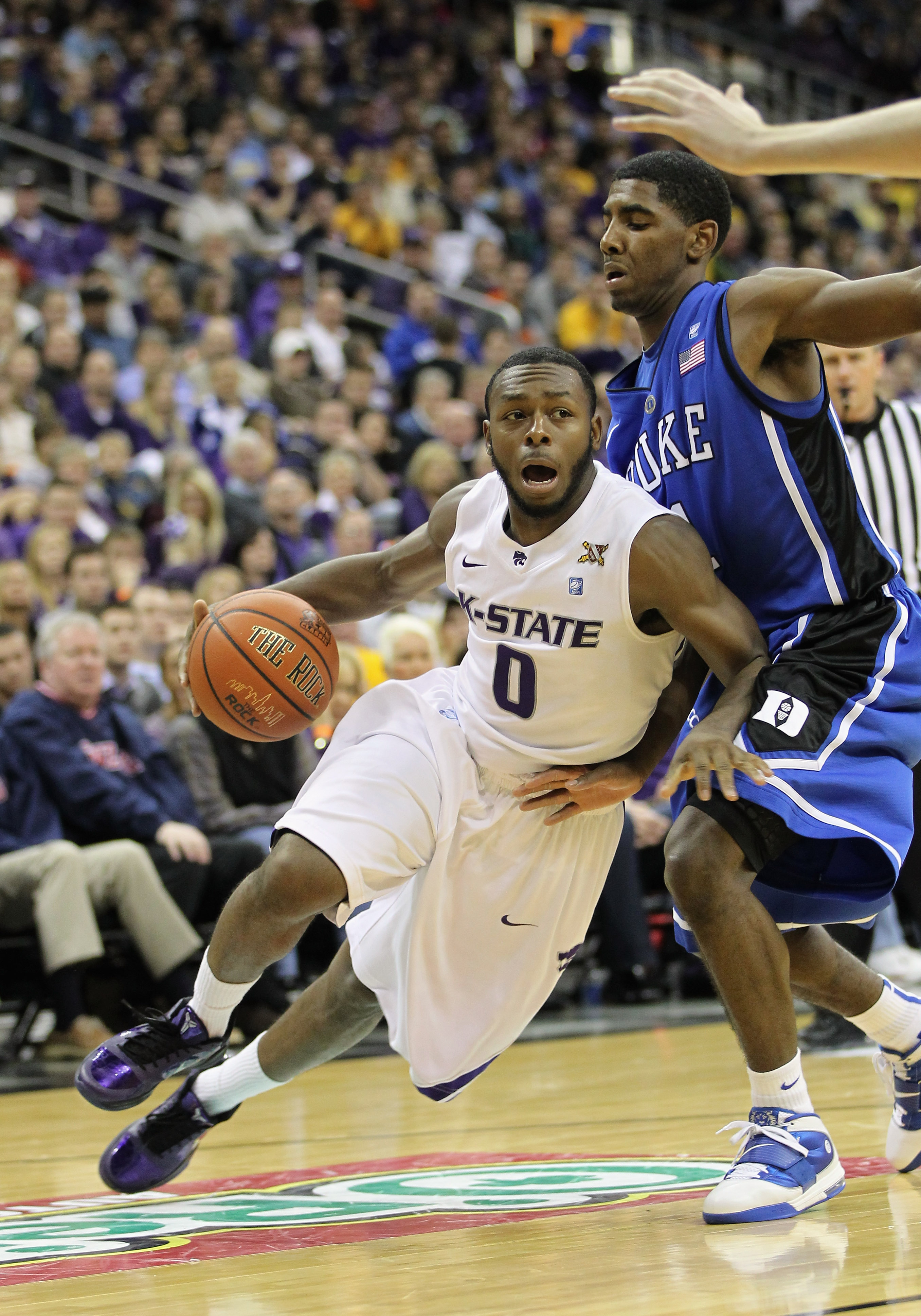 KANSAS CITY, MO - NOVEMBER 23:  Jacob Pullen #0 of the Kansas State Wildcats drives as Kyrie Irving #1 of the Duke Blue Devils defends during the CBE Classic championship game on November 23, 2010 at the Sprint Center in Kansas City, Missouri.  (Photo by