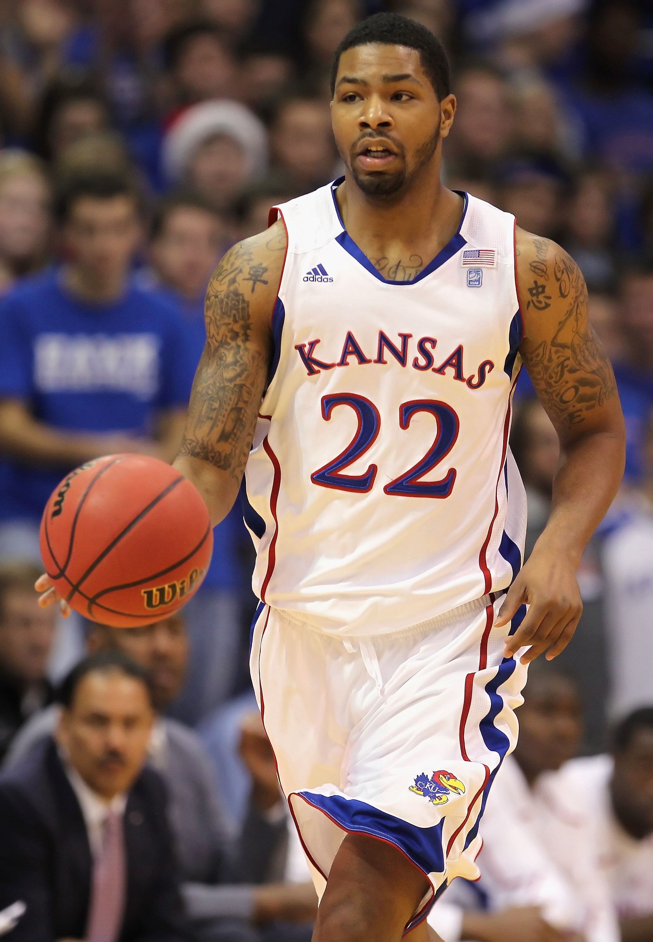 LAWRENCE, KS - DECEMBER 18:  Marcus Morris #22 of the Kansas Jayhawks in action during the game against the USC Trojans on December 18, 2010 at Allen Fieldhouse in Lawrence, Kansas.  (Photo by Jamie Squire/Getty Images)