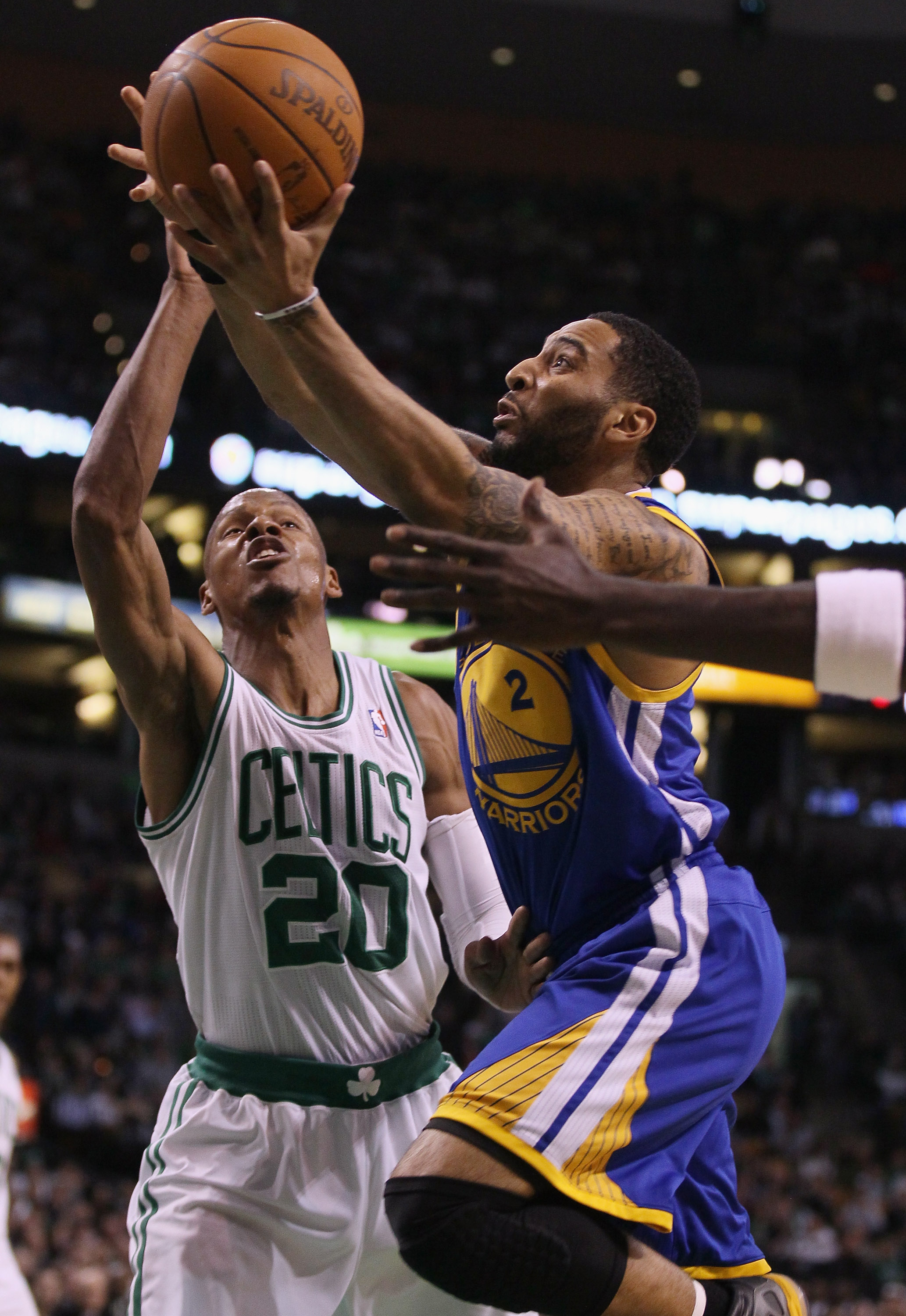 BOSTON, MA - MARCH 04:  Acie Law #2 of the Golden State Warriors takes a shot as Ray Allen #20 of the Boston Celtics defends on March 4, 2011 at the TD Garden in Boston, Massachusetts.  The Celtics defeated the Warriors 107-103. NOTE TO USER: User express