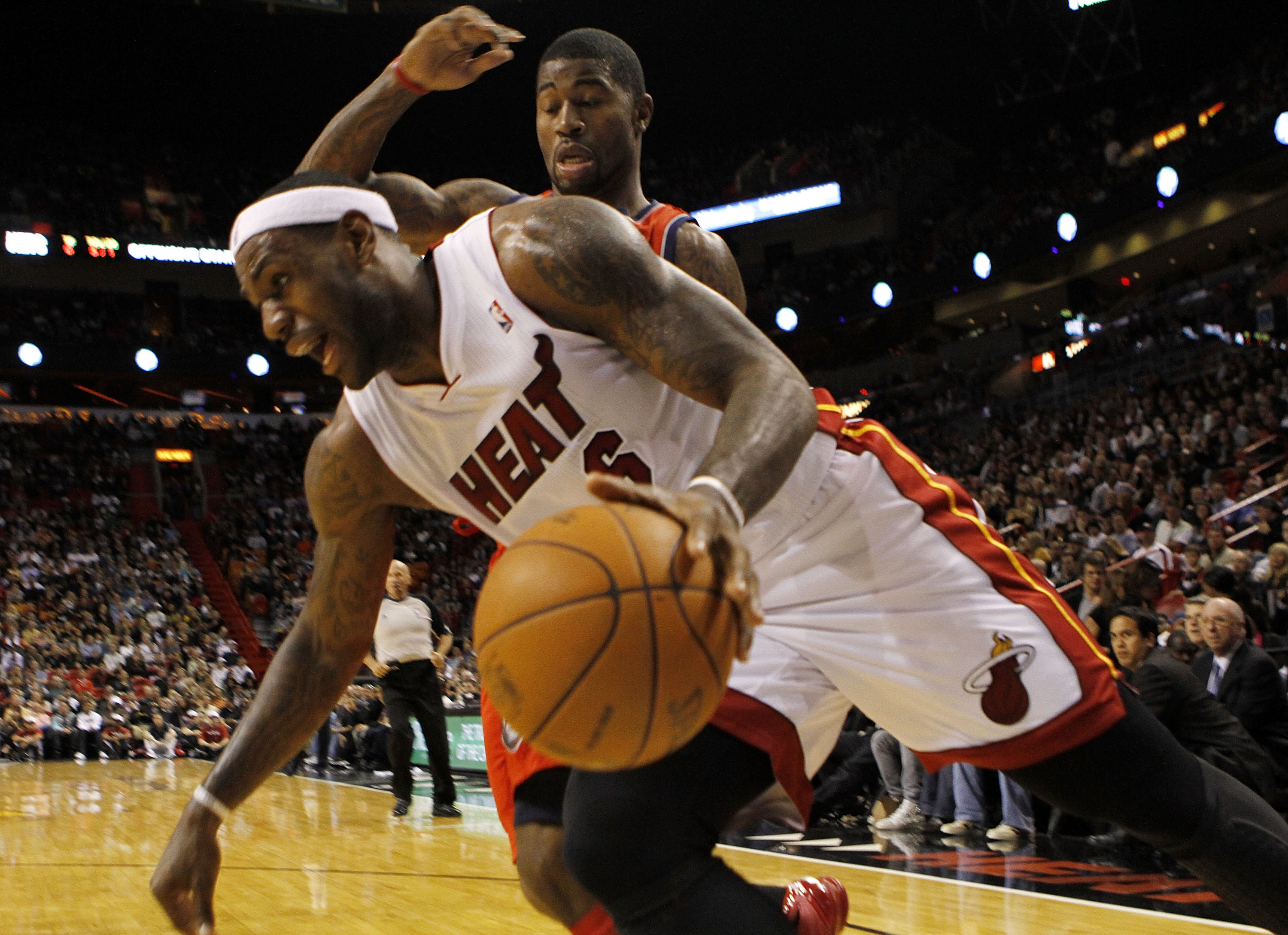 MIAMI - NOVEMBER 06:  Forward LeBron James #6 of the Miami Heat drives against guard Terrence Williams #1 of the New Jersey Nets  at American Airlines Arena on November 6, 2010 in Miami, Florida. NOTE TO USER: User expressly acknowledges and agrees that,