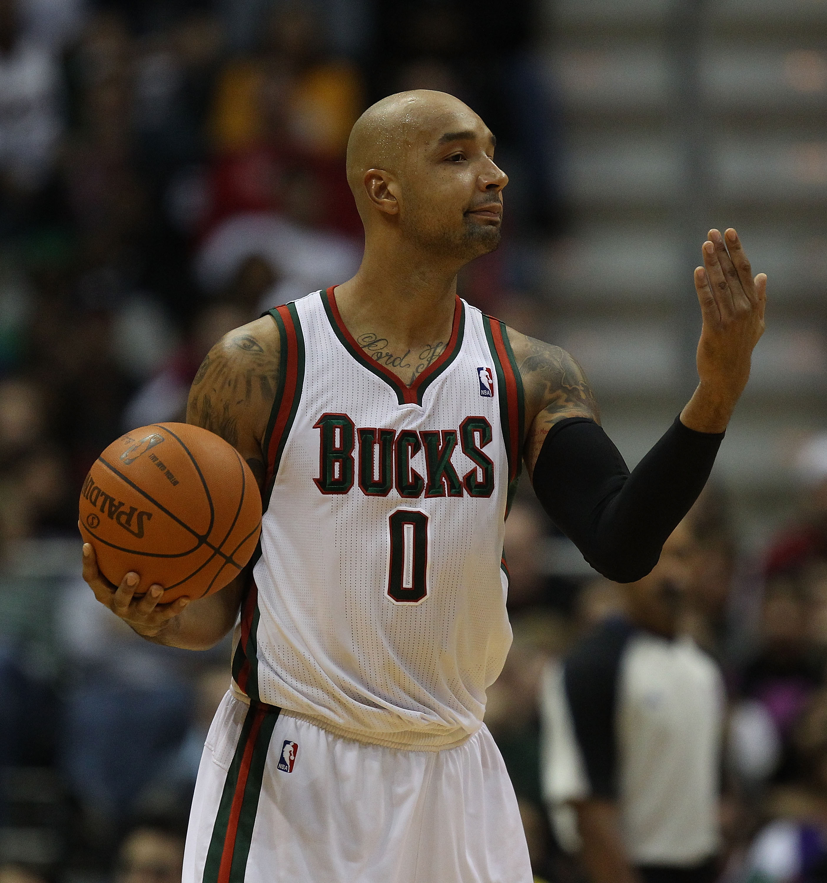 MILWAUKEE, WI - NOVEMBER 16: Drew Gooden #0 of the Milwaukee Bucks signals to a teammate against the Los Angeles Lakers at the Bradley Center on November 16, 2010 in Milwaukee, Wisconsin. The Lakers defeated the Bucks 118-107. NOTE TO USER: User expressly