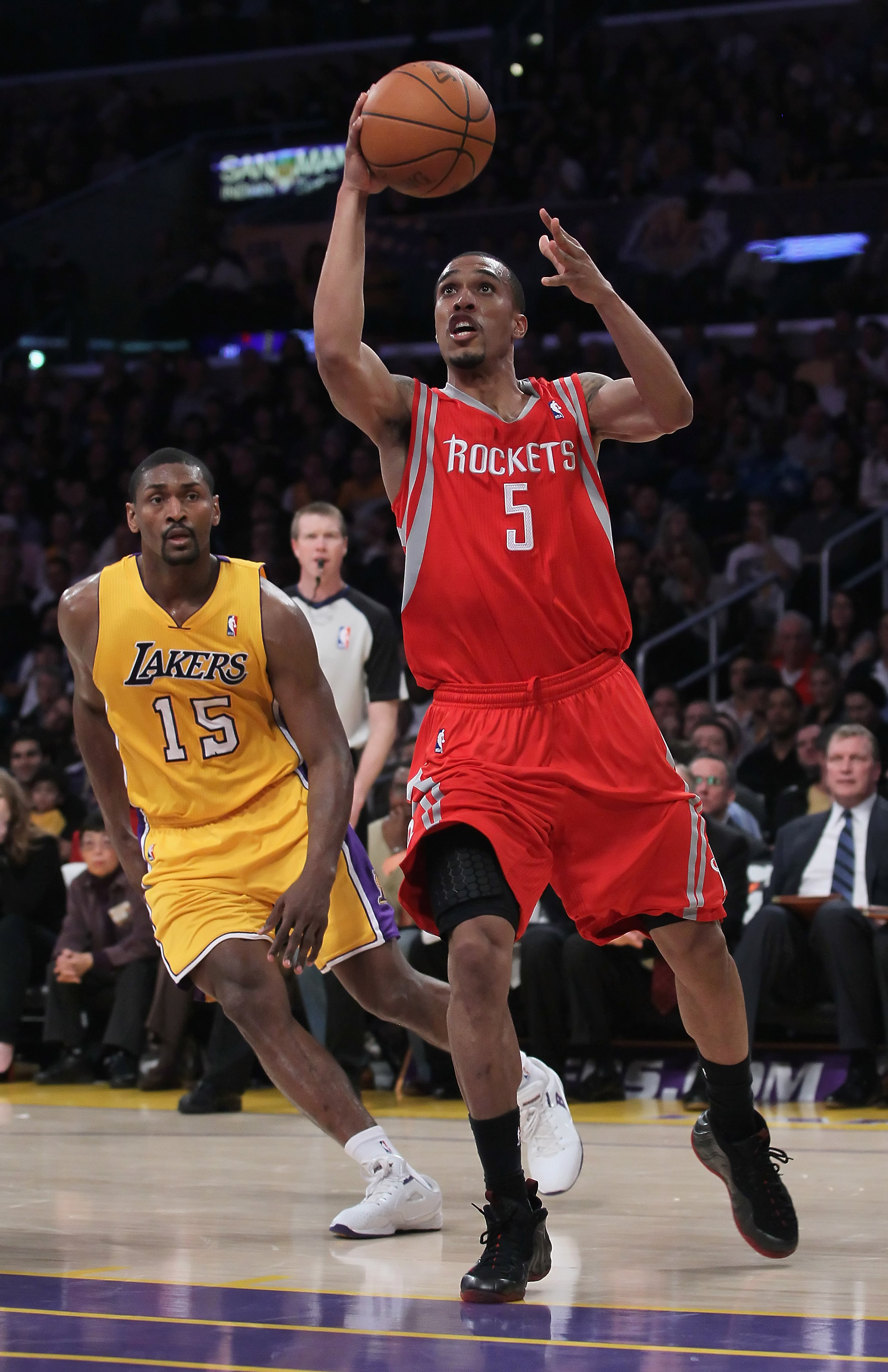 LOS ANGELES, CA - FEBRUARY 01:  Courtney Lee #5 of the Houston Rockets drives past Ron Artest #15 of the Los Angeles Lakers in the second half at Staples Center on February 1, 2011 in Los Angeles, California. The Lakers defeated the Rockets 114-106. NOTE