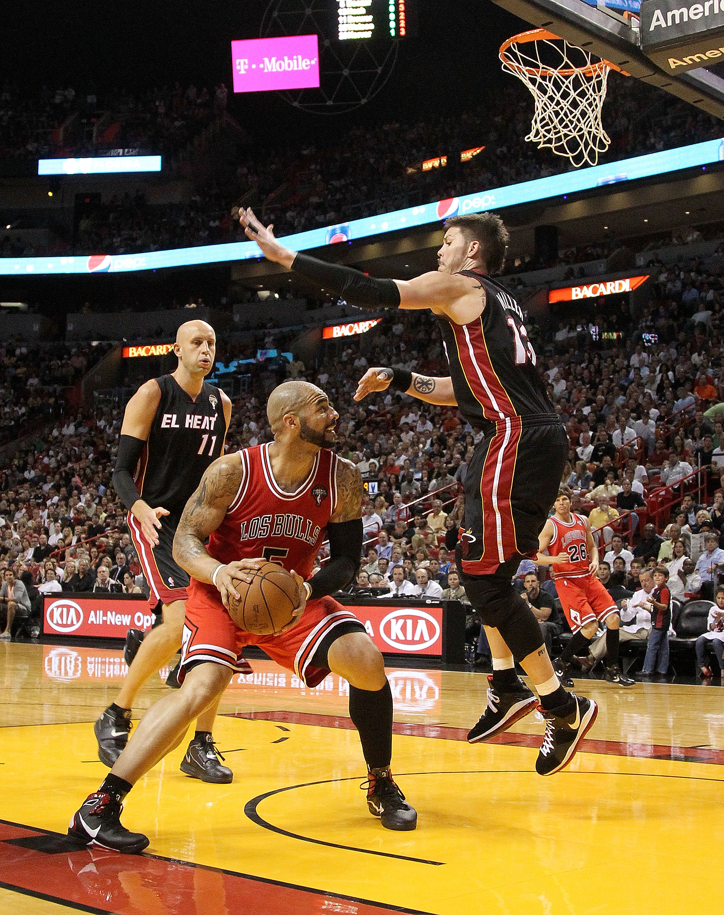 MIAMI, FL - MARCH 06:  Carlos Boozer #5 of  the Chicago Bulls posts up Mike Miller #13 of the Miami Heat during a game at American Airlines Arena on March 6, 2011 in Miami, Florida. NOTE TO USER: User expressly acknowledges and agrees that, by downloading