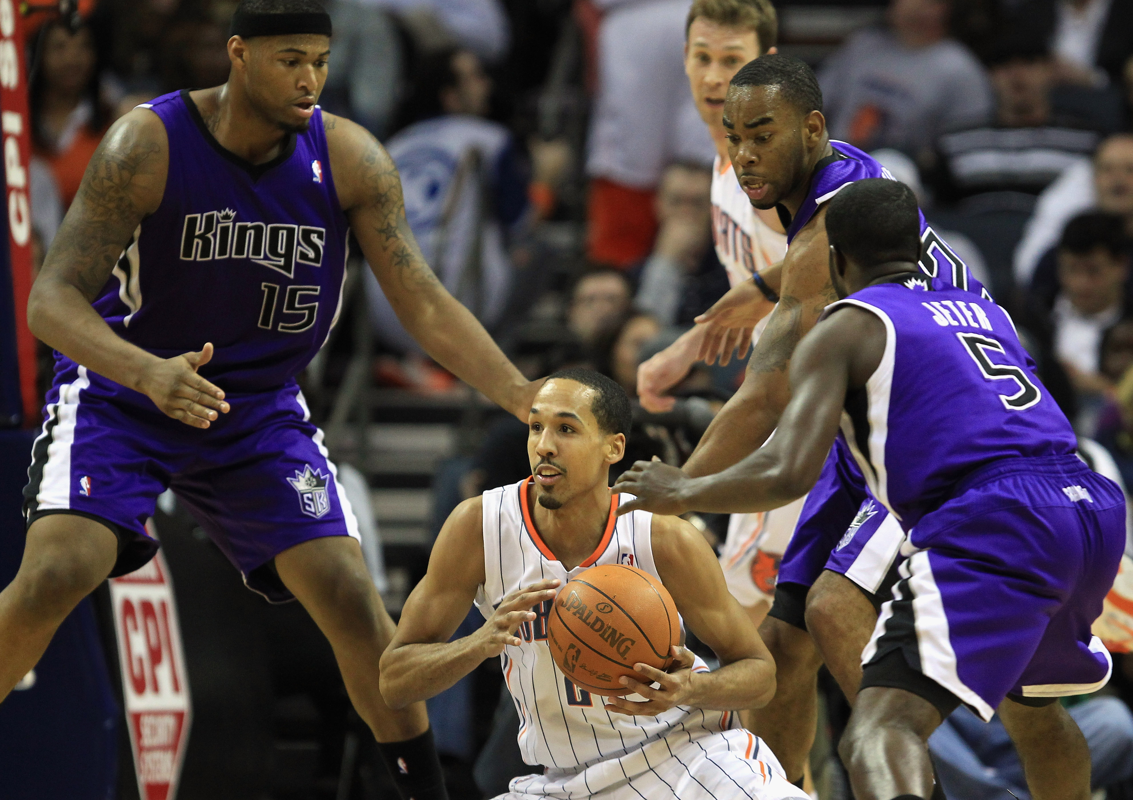 CHARLOTTE, NC - FEBRUARY 25:  Eugene Jeter #5 of the Sacramento Kings tries to steal the ball from Shaun Livingston #2 of the Charlotte Bobcats during their game at Time Warner Cable Arena on February 25, 2011 in Charlotte, North Carolina. NOTE TO USER: U