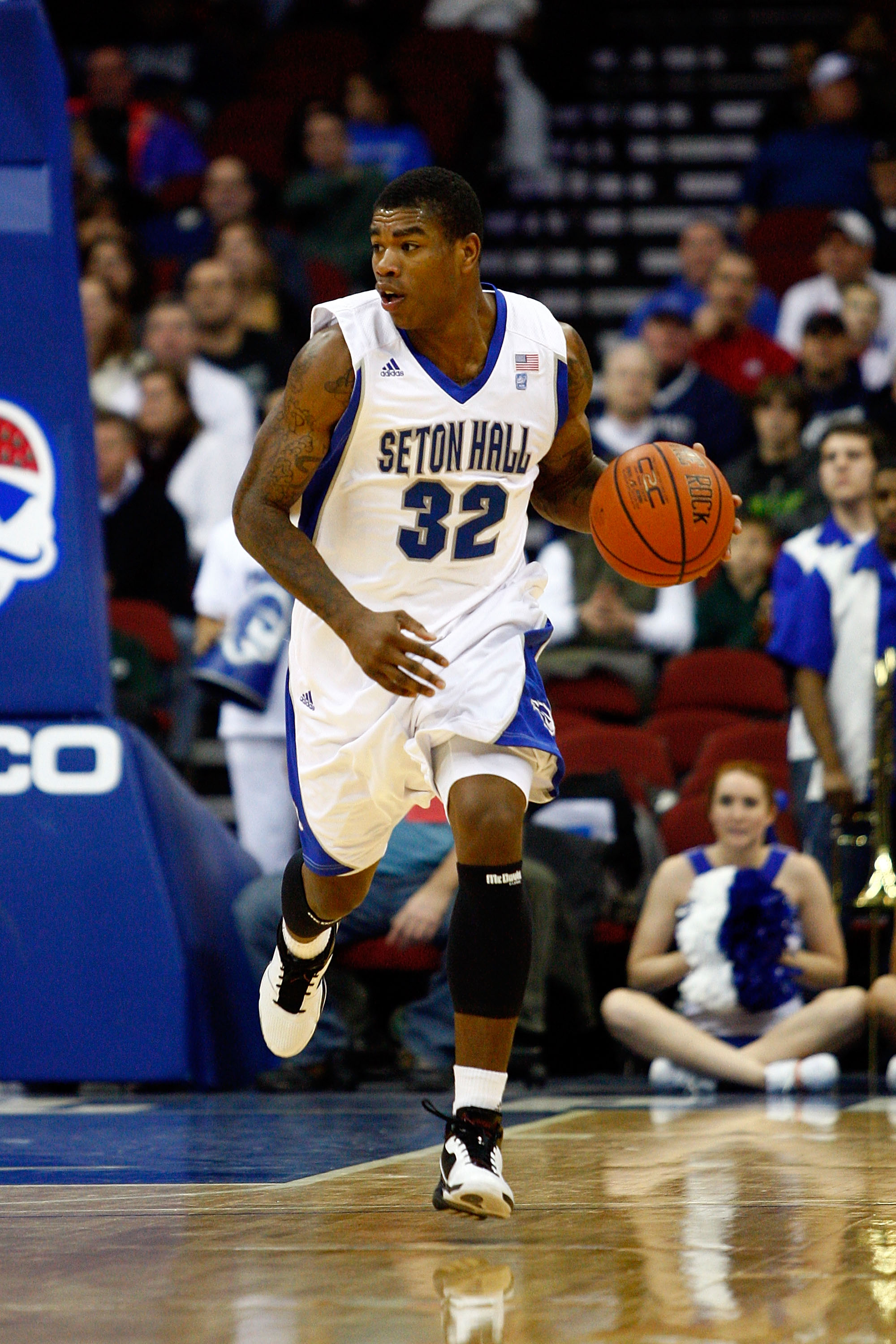 NEWARK, NJ - DECEMBER 22:  Jeff Robinson #32 of the Seton Hall Pirates brings the ball up court against the Dayton Flyers at Prudential Center on December 22, 2010 in Newark, New Jersey. Dayton 69-65. (Photo by Chris Chambers/Getty Images)