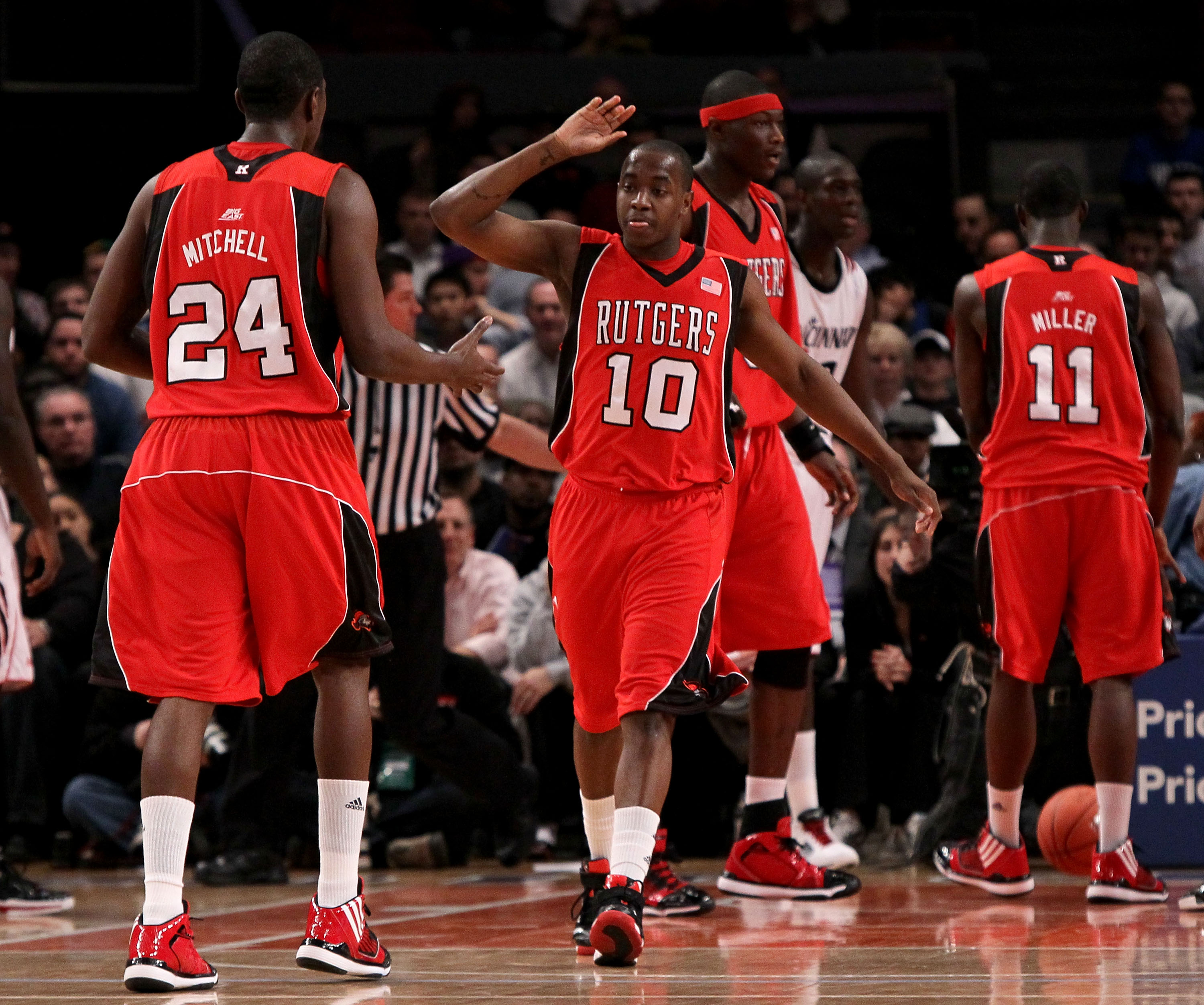 NEW YORK - MARCH 09: James Beatty #10 and Jonathan Mitchell #24 of the Rutgers Scarlet Knights react after a play against the Cincinnati Bearcats during the first round game of the Big East Basketball Tournament at Madison Square Garden on March 9, 2010 i
