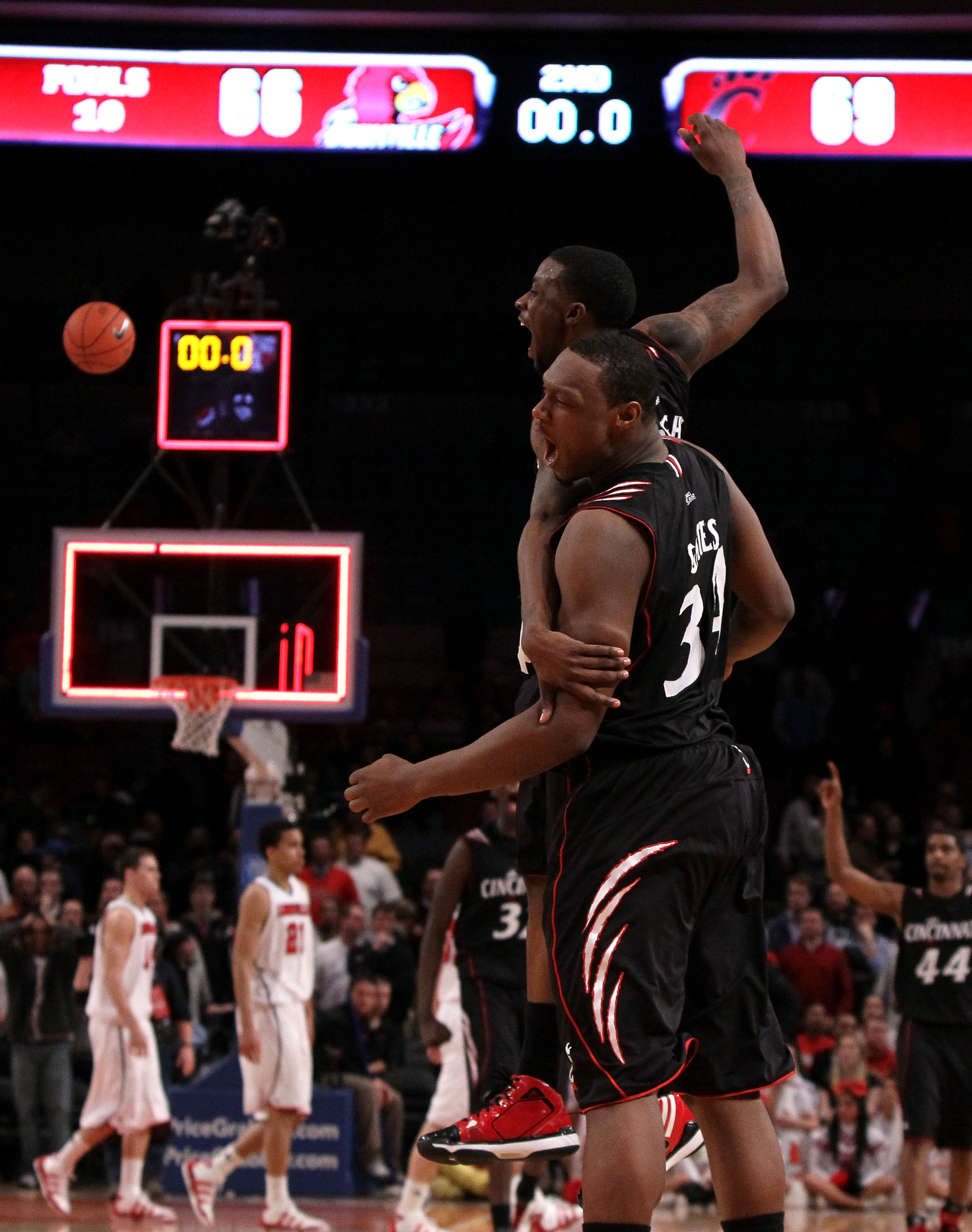 NEW YORK - MARCH 10:  Cashmere Wright #1 and Yancy Gates #34 of the Cincinnati Bearcats celebrate after defeating the Louisville Cardinals during the second round of 2010 NCAA Big East Tournament at Madison Square Garden on March 10, 2010 in New York City