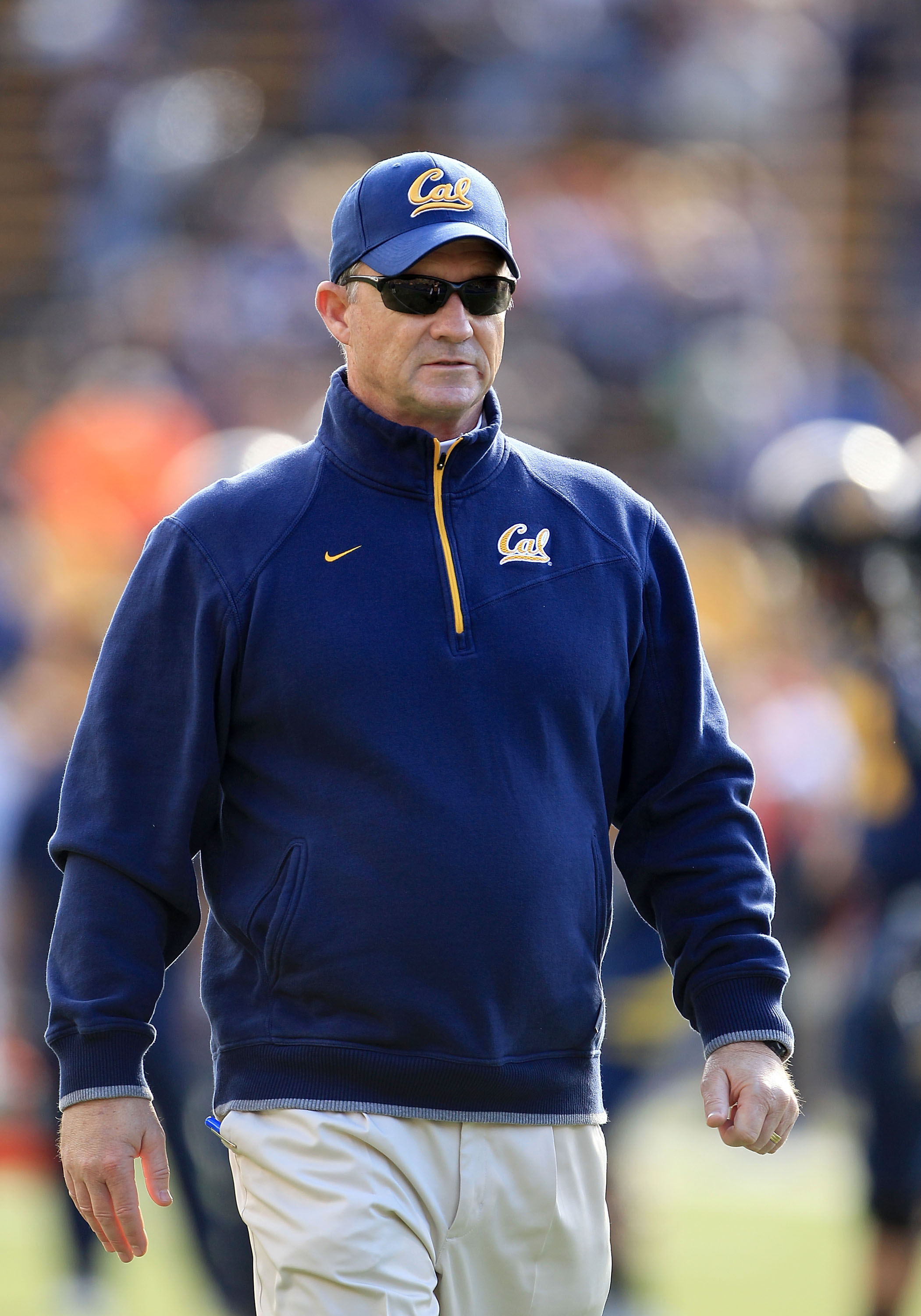 BERKELEY, CA - NOVEMBER 20:  Head coach Jeff Tedford of the California Golden Bears watches his team warm up before their game against the Stanford Cardinal at California Memorial Stadium on November 20, 2010 in Berkeley, California.  (Photo by Ezra Shaw/