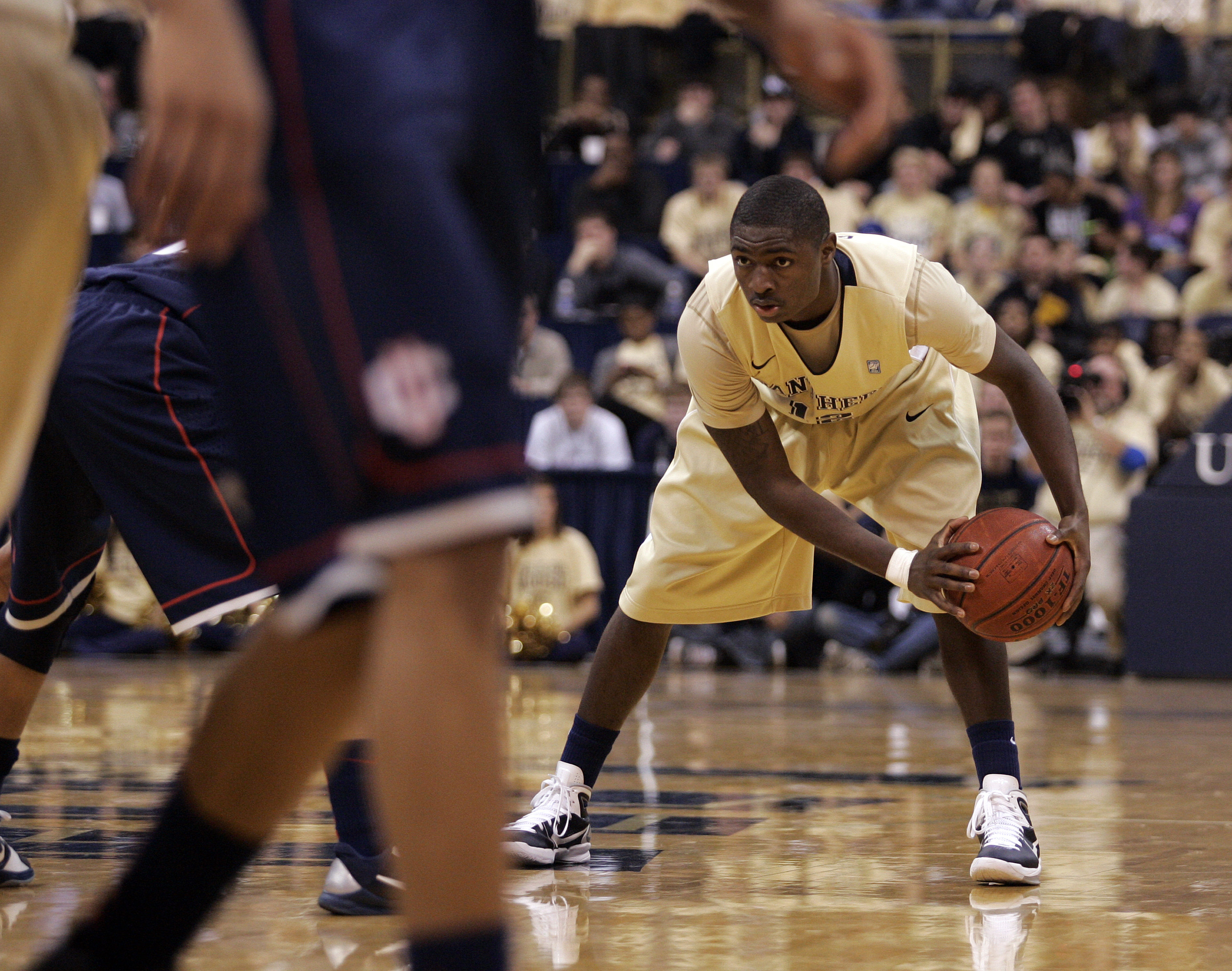 PITTSBURGH, PA - DECEMBER 27:  Ashton Gibbs #12 of the Pittsburgh Panthers looks to make a pass against the Connecticut Huskies at Petersen Events Center on December 27, 2010 in Pittsburgh, Pennsylvania.  Pittsburgh defeated Connecticut 78-64.  (Photo by