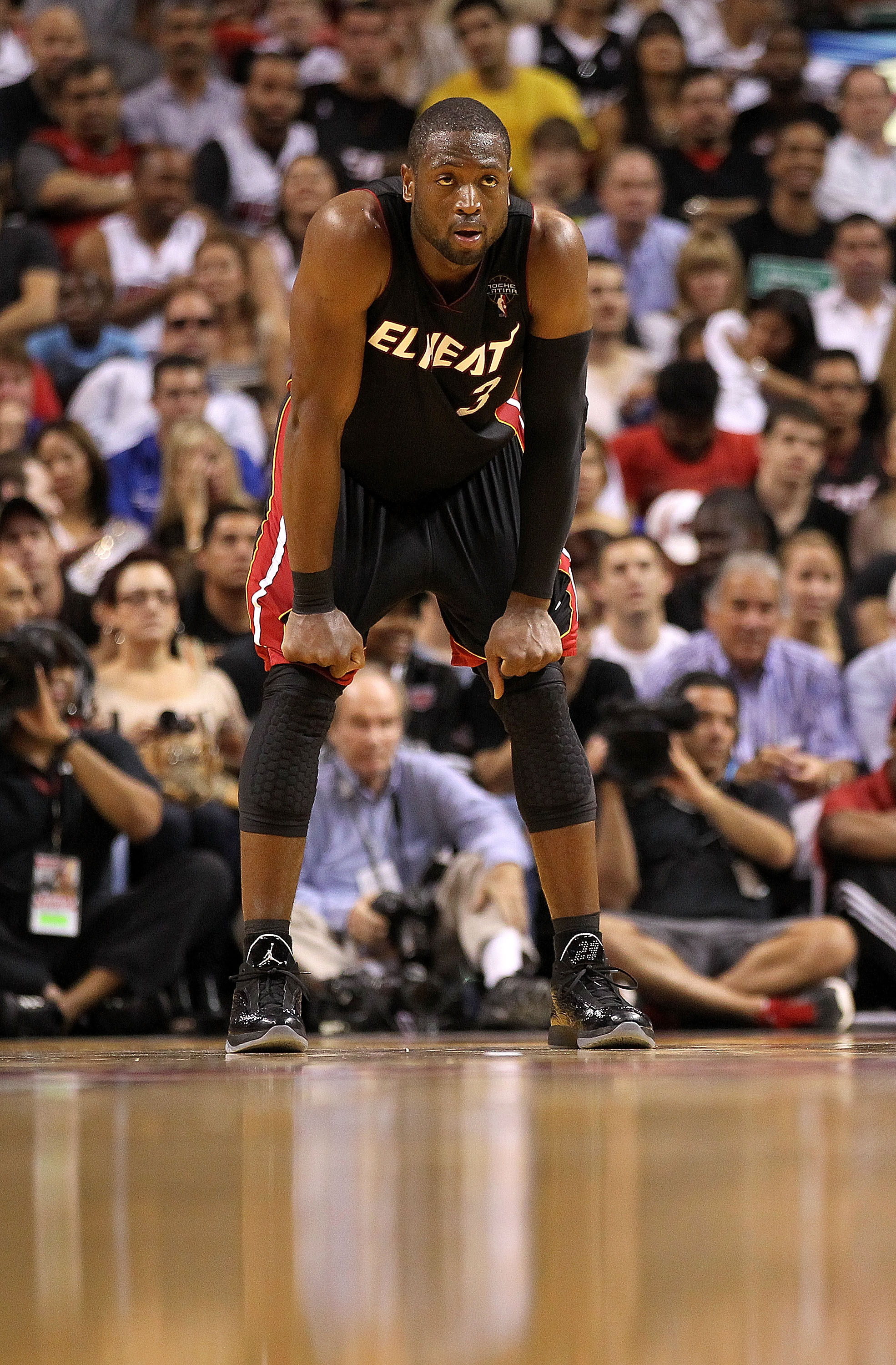 MIAMI, FL - MARCH 06:  Dwyane Wade #3 of the Miami Heat looks on during a game against the Chicago Bulls at American Airlines Arena on March 6, 2011 in Miami, Florida. NOTE TO USER: User expressly acknowledges and agrees that, by downloading and/or using