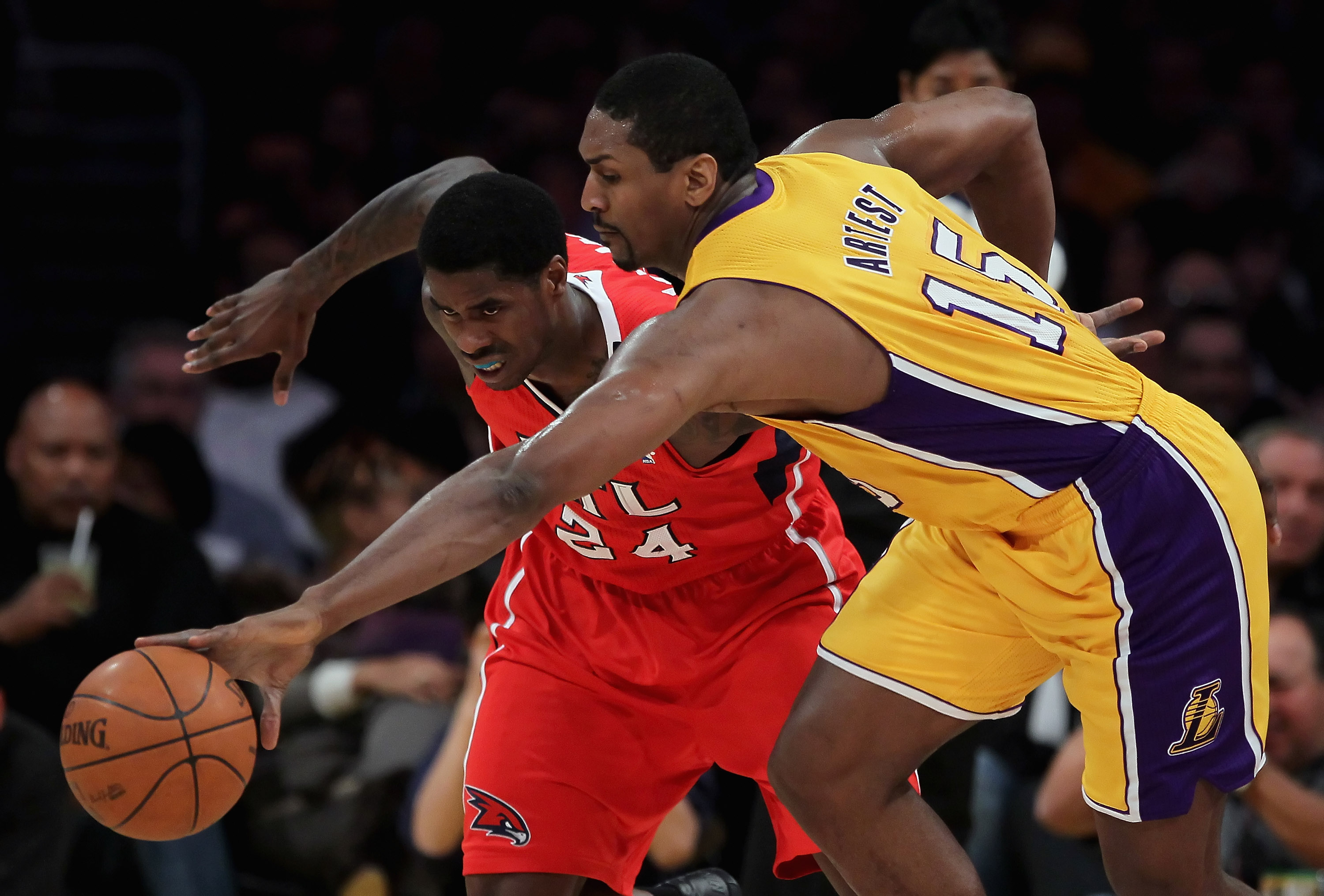 LOS ANGELES, CA - FEBRUARY 22:  Ron Artest #15 of the Los Angeles Lakers steals the ball from Marvin Williams #24 of the Atlanta Hawks in the first half at Staples Center on February 22, 2011 in Los Angeles, California. The Lakers defeated the Hawks 104-8