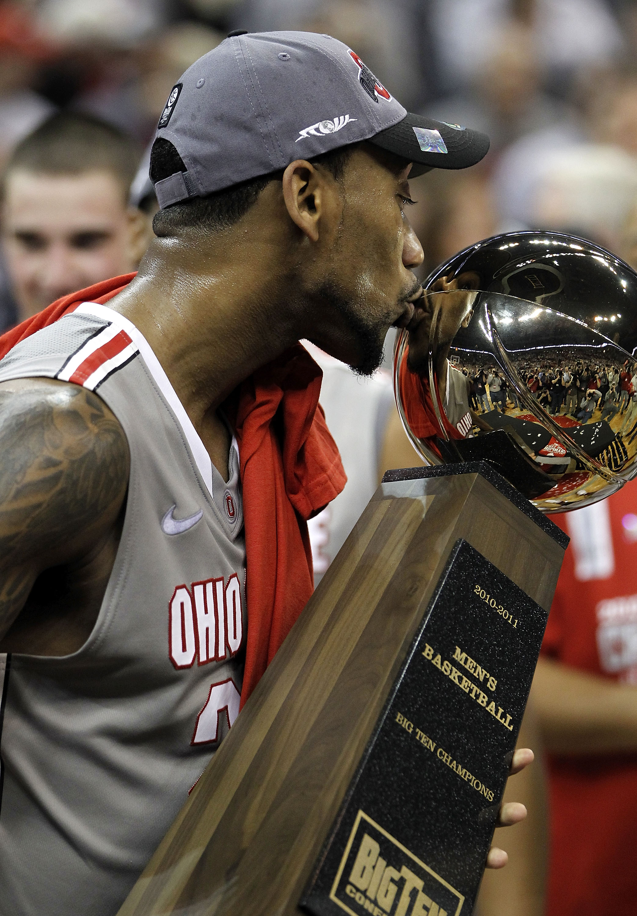 COLUMBUS, OH - MARCH 06:  David Lighty #23 of the Ohio State Buckeyes kisses the Big Ten trophy after beating the Wisconsin Badgers 93-65 on March 6, 2011 at the Value City Arena in Columbus, Ohio.  (Photo by Gregory Shamus/Getty Images)