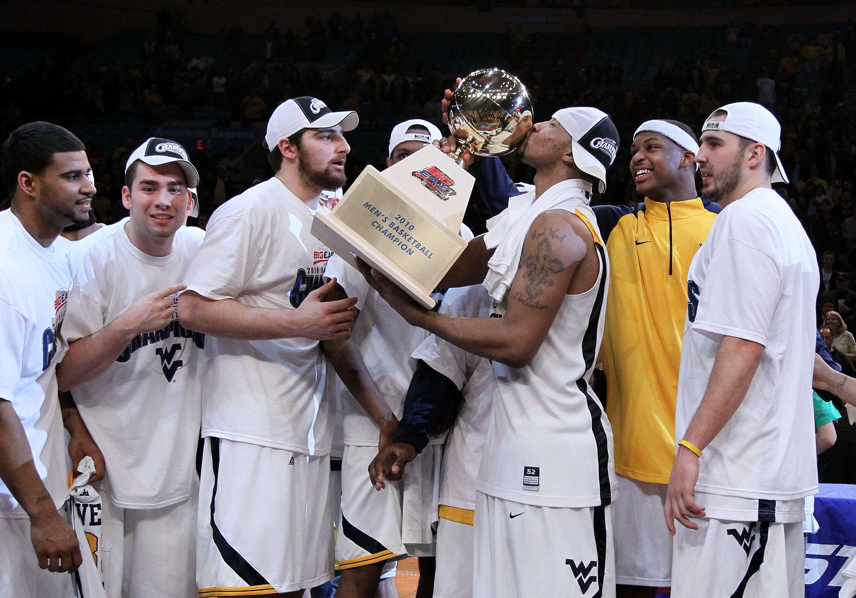 NEW YORK - MARCH 13: Da'Sean Butler #1 of the West Virginia Mountaineers kisses the championship trophy after defeating the Georgetown Hoyas during the championship of the 2010 NCAA Big East Tournament at Madison Square Garden on March 13, 2010 in New Yor