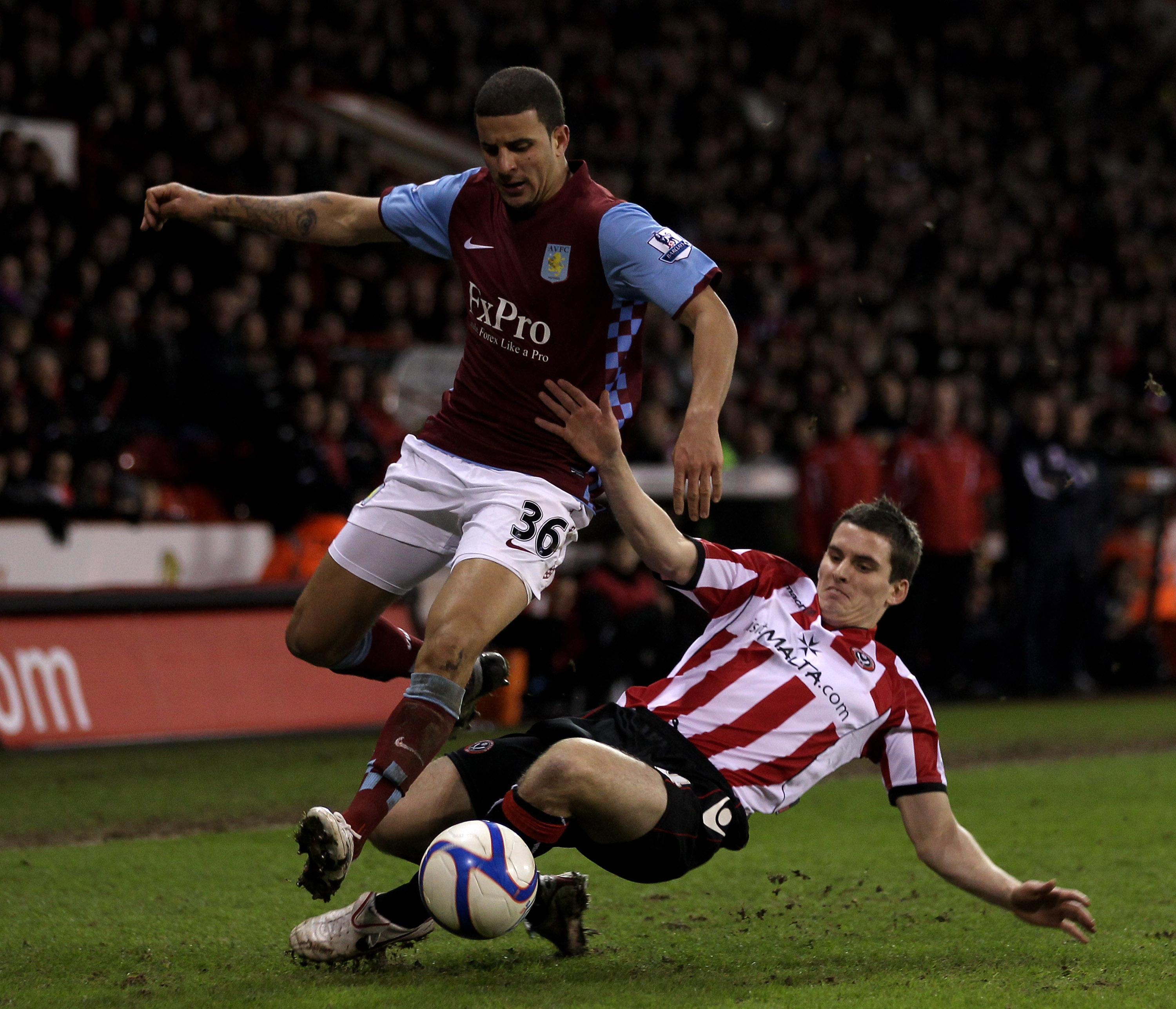SHEFFIELD, ENGLAND - JANUARY 08:  David McAllister of Sheffield United (R) challenges Kyle Walker of Aston Villa during the FA Cup sponsored by E.ON 3rd Round match between Sheffield United and Aston Villa at Bramall Lane on January 8, 2011 in Sheffield,