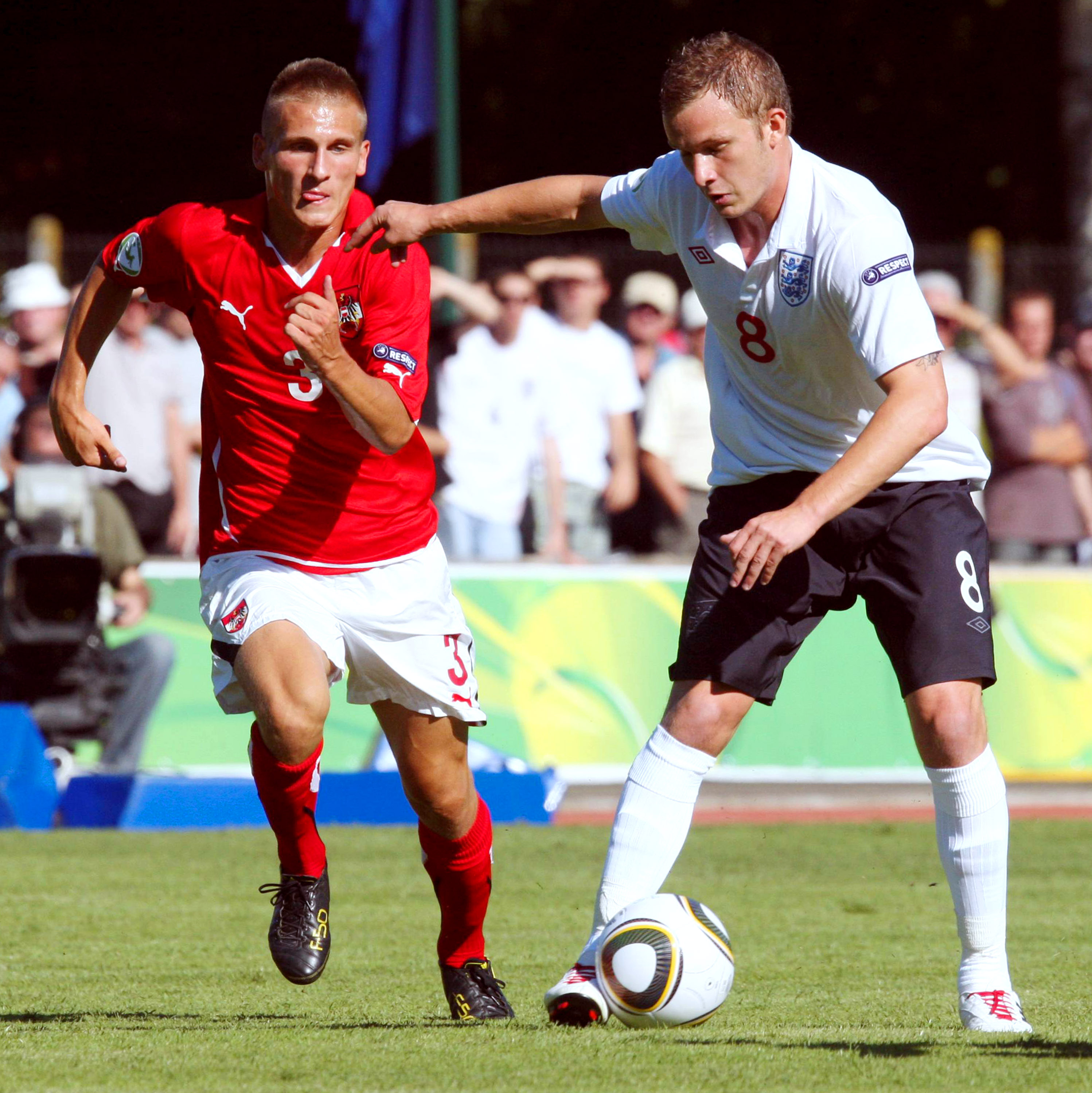 FLERS, FRANCE - JULY 18: Emir Dilaver of Austria and Dean Parrett of England in action during the UEFA European Under-19 Championship Final Tournament Group A match between Austria and England at Stade du Haze on July 18, 2010 in Flers, France.  (Photo by