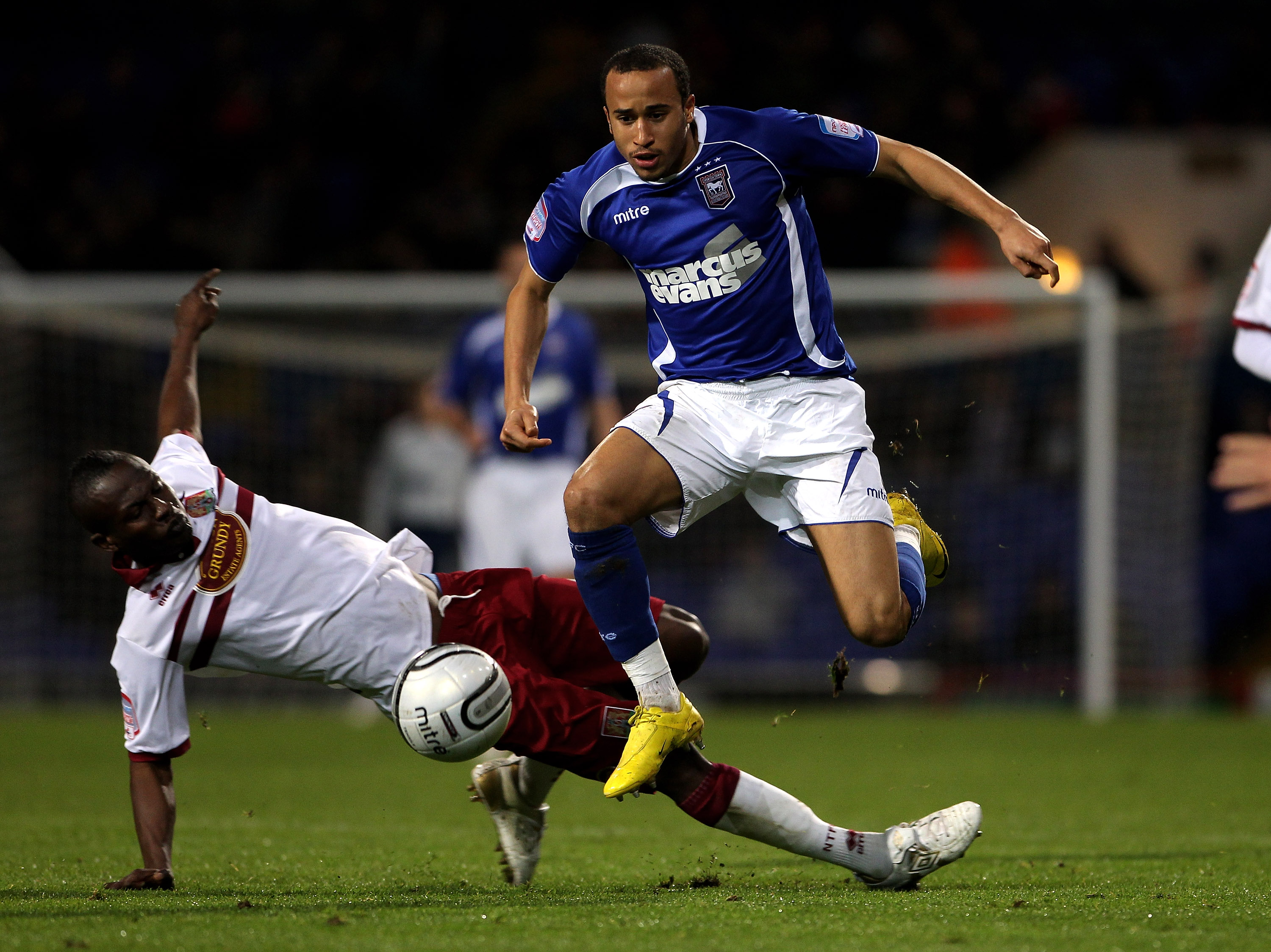 IPSWICH, ENGLAND - OCTOBER 26:  Andros Townsend of Ipswich Town moves away from Abdul Osman during the Carling Cup fourth round match between Ipswich Town and Northampton Town at Portman Road on October 26, 2010 in Ipswich, England.  (Photo by David Roger