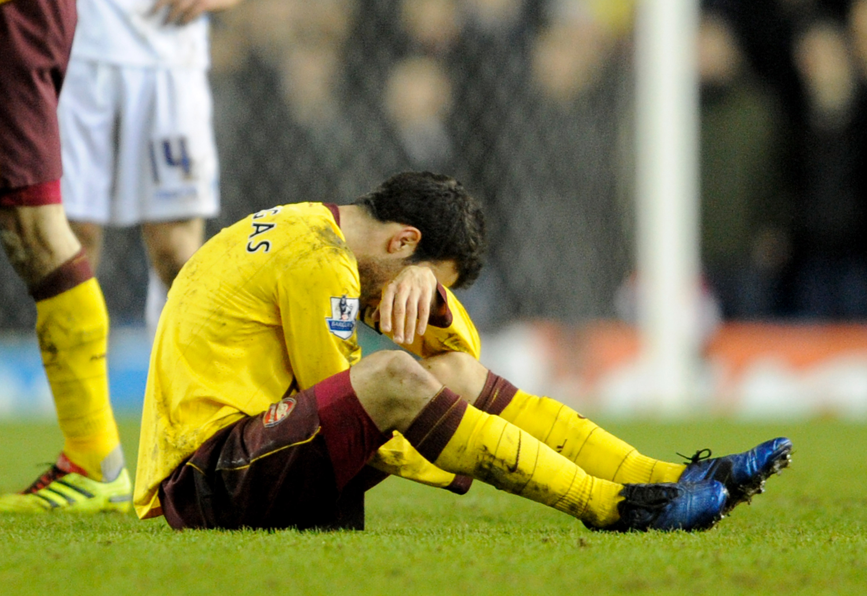 LEEDS, UNITED KINGDOM - JANUARY 19:   Cesc Fabregas of Arsenal goes down injured during the FA Cup sponsored by E.On Third Round Replay match between Leeds United and Arsenal at Elland Road on January 19, 2011 in Leeds, England. (Photo by Michael Regan/Ge