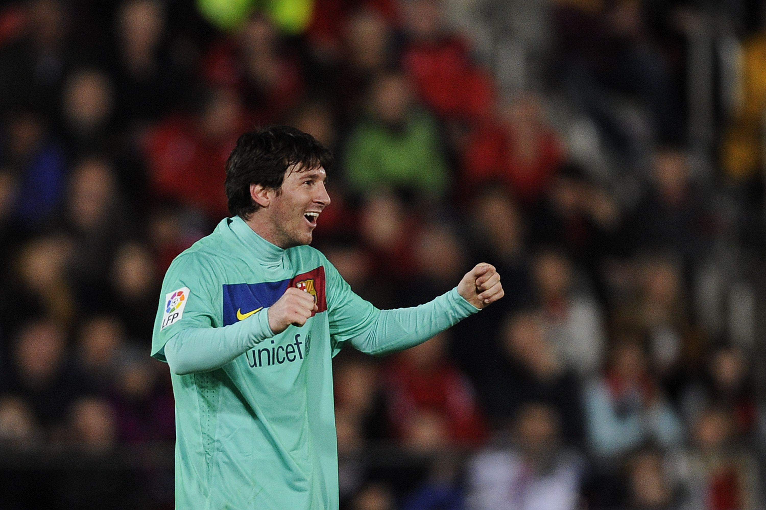 MALLORCA, SPAIN - FEBRUARY 26: Lionel Messi of Barcelona celebrates after scoring his first team's goal during the La Liga match between Mallorca and Barcelona at Iberstar Stadium on February 26, 2011 in Mallorca, Spain.  (Photo by David Ramos/Getty Image