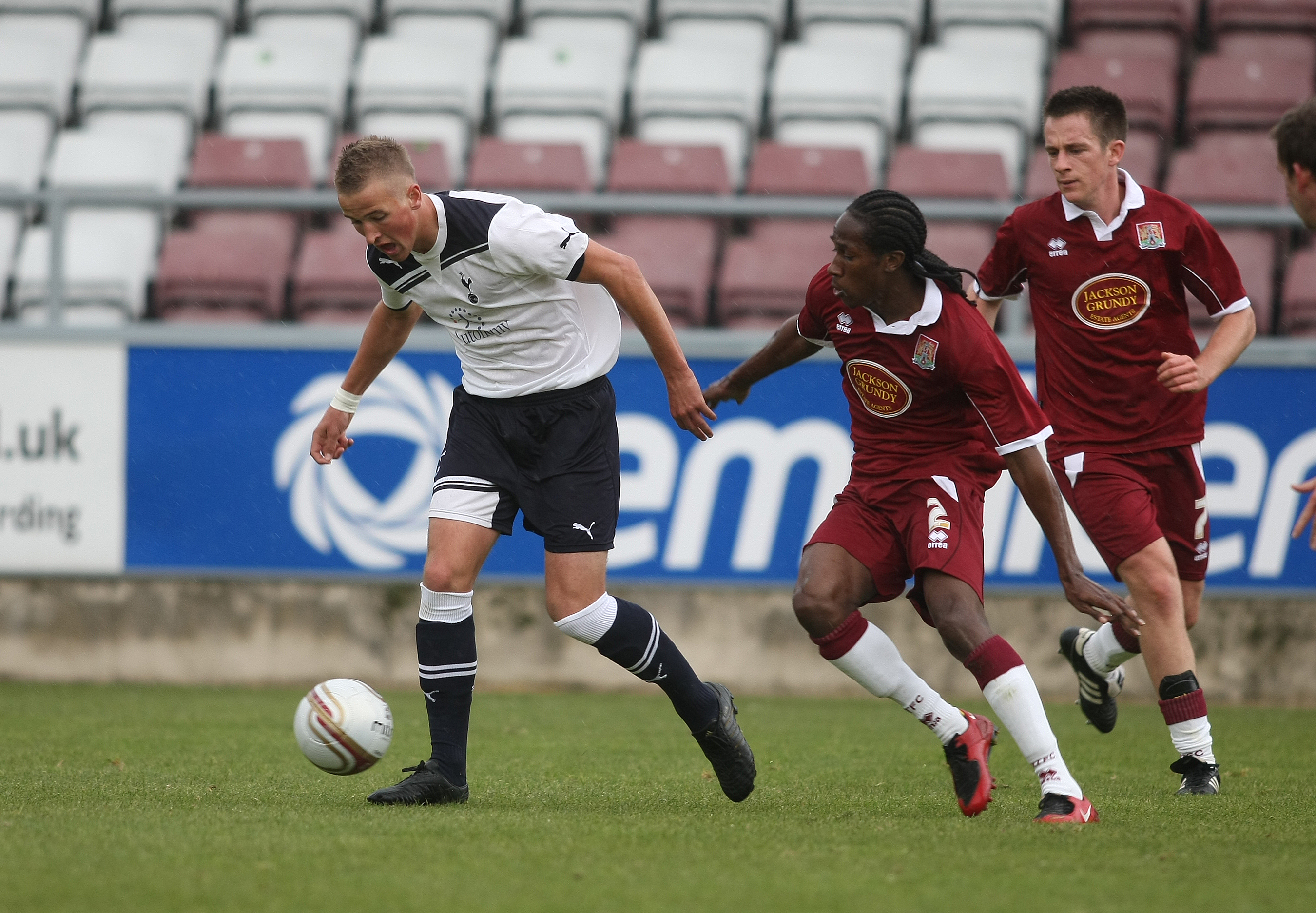 NORTHAMPTON, ENGLAND - OCTOBER 19:  Harry Kane of Tottenham Hotspur moves away with the ball from Paul Rodgers of Northampton Town during a Behind Closed Doors Friendly Match between Northampton Town and Tottenham Hotspur at Sixfields Stadium on October 1
