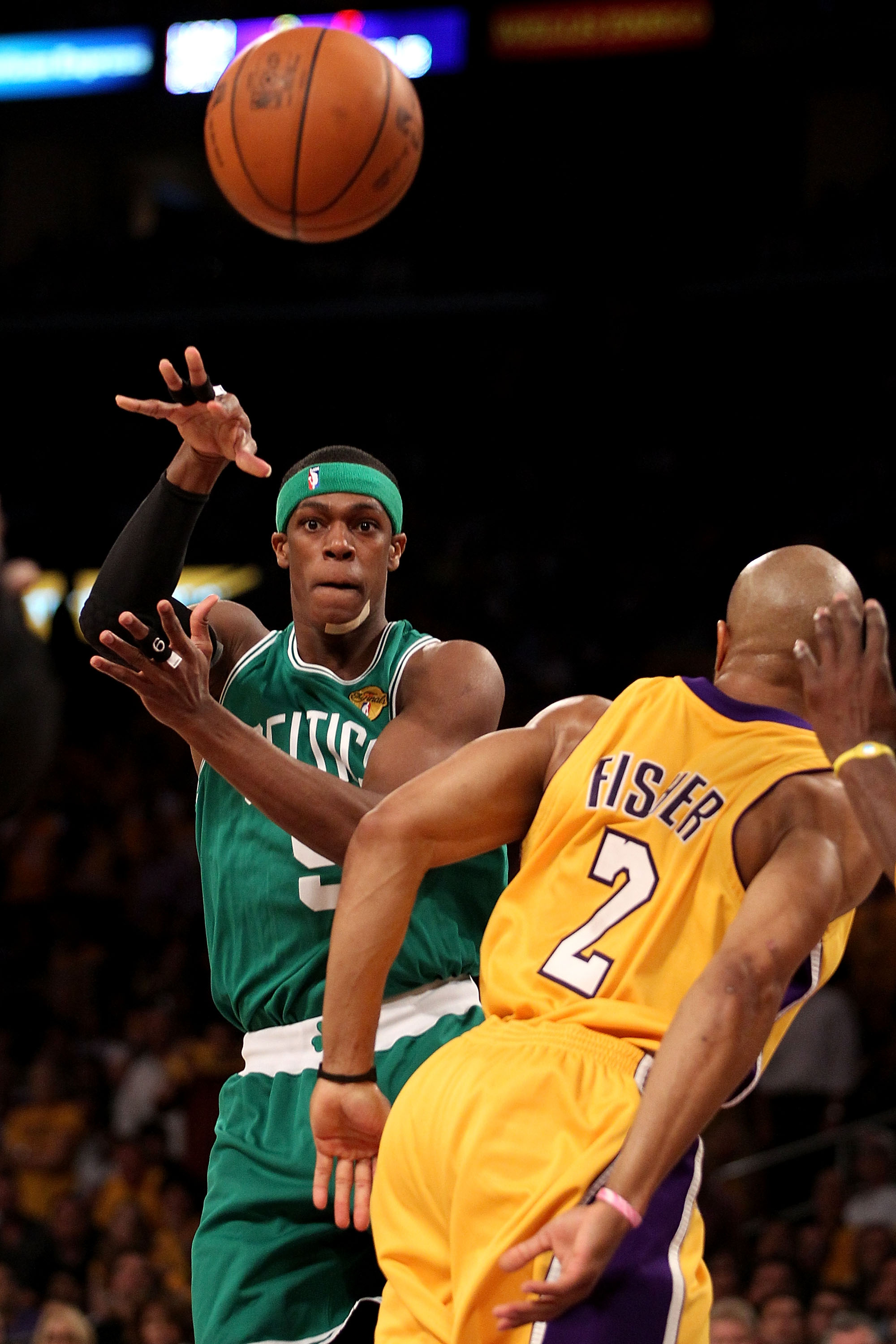 LOS ANGELES, CA - JUNE 17:  Rajon Rondo #9 of the Boston Celtics passes the ball over Derek Fisher #2 of the Los Angeles Lakers in Game Seven of the 2010 NBA Finals at Staples Center on June 17, 2010 in Los Angeles, California.  NOTE TO USER: User express