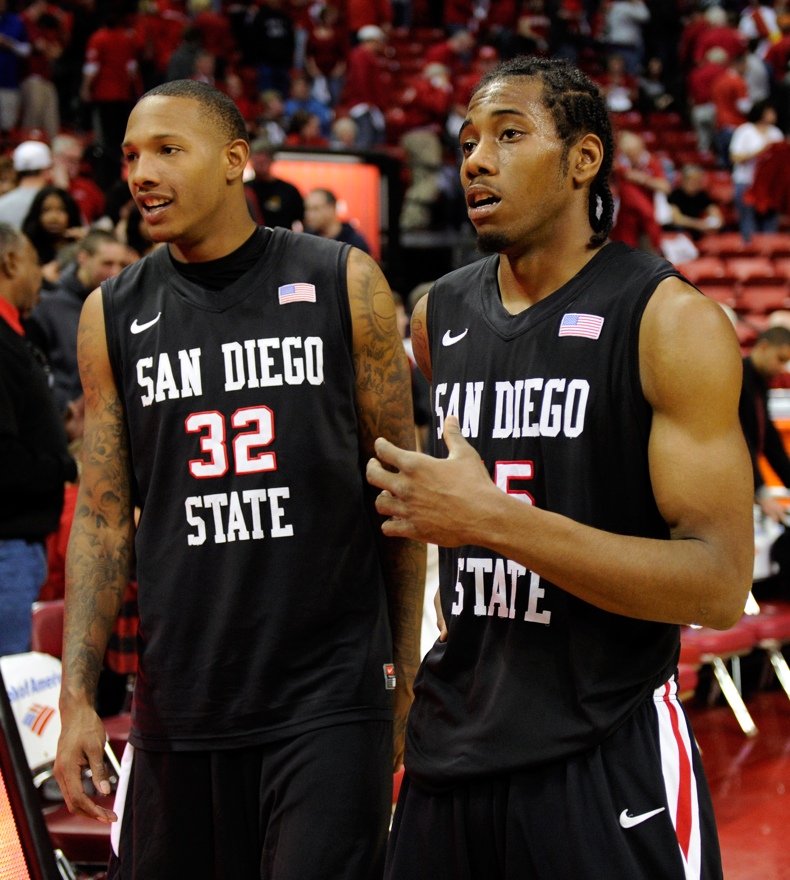 LAS VEGAS, NV - FEBRUARY 12:  Billy White #32 and and Kawhi Leonard #15 of the San Diego State Aztecs celebrate their 63-57 victory over the UNLV Rebels at the Thomas & Mack Center February 12, 2011 in Las Vegas, Nevada.  (Photo by Ethan Miller/Getty Imag