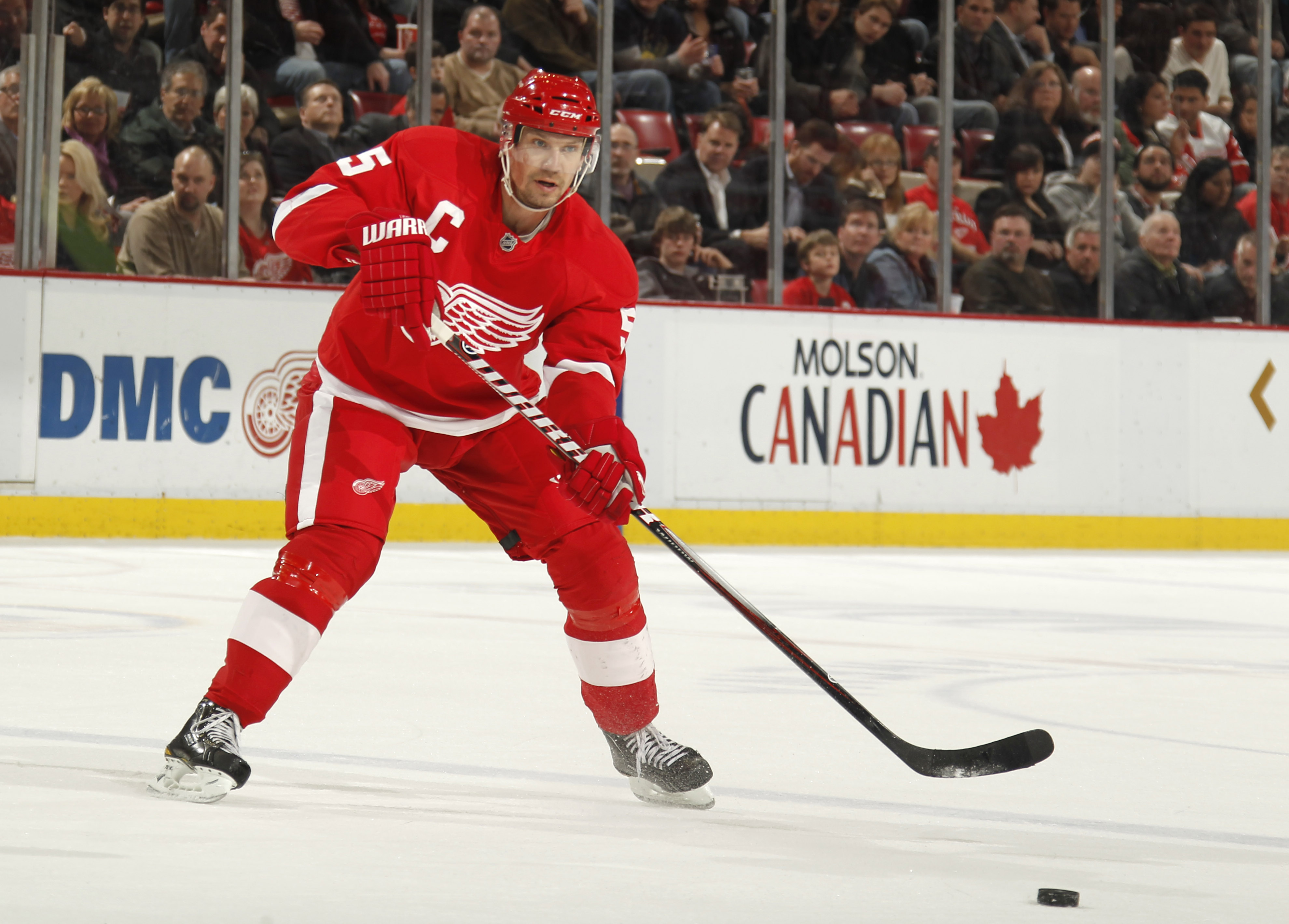 DETROIT, MI - FEBRUARY 24:  Nicklas Lidstrom #5 of the Detroit Red Wings skates with the puck while playing against the Dallas Stars on February 24, 2011 at Joe Louis Arena in Detroit, Michigan.  (Photo by Gregory Shamus/Getty Images)