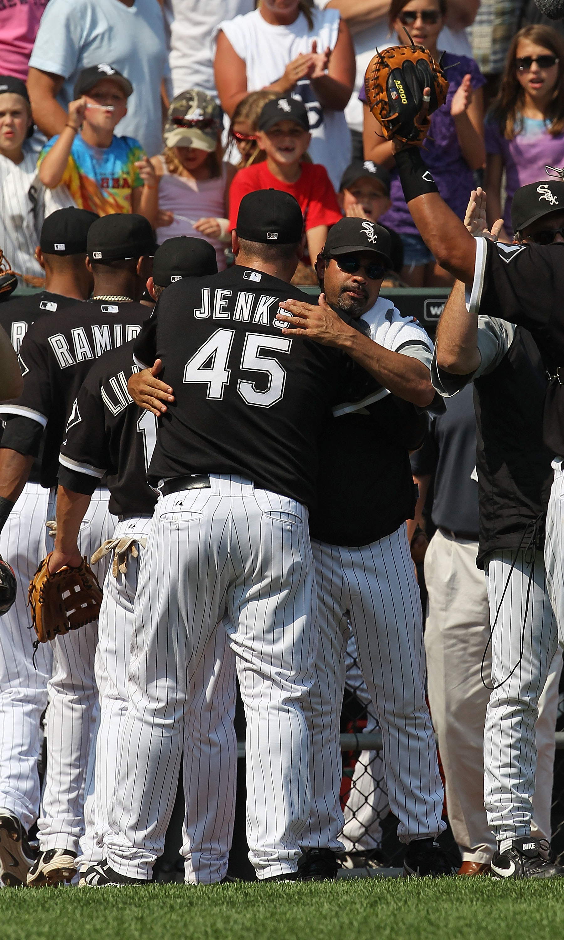 CHICAGO - AUGUST 01: Manager Ozzie Guillen #13 of the Chicago White Sox hugs closing pitcher Bobby Jenks #45 after a win over the Oakland Athletics at U.S. Cellular Field on August 1, 2010 in Chicago, Illinois. The White Sox defeated the Athletics 4-1. (P