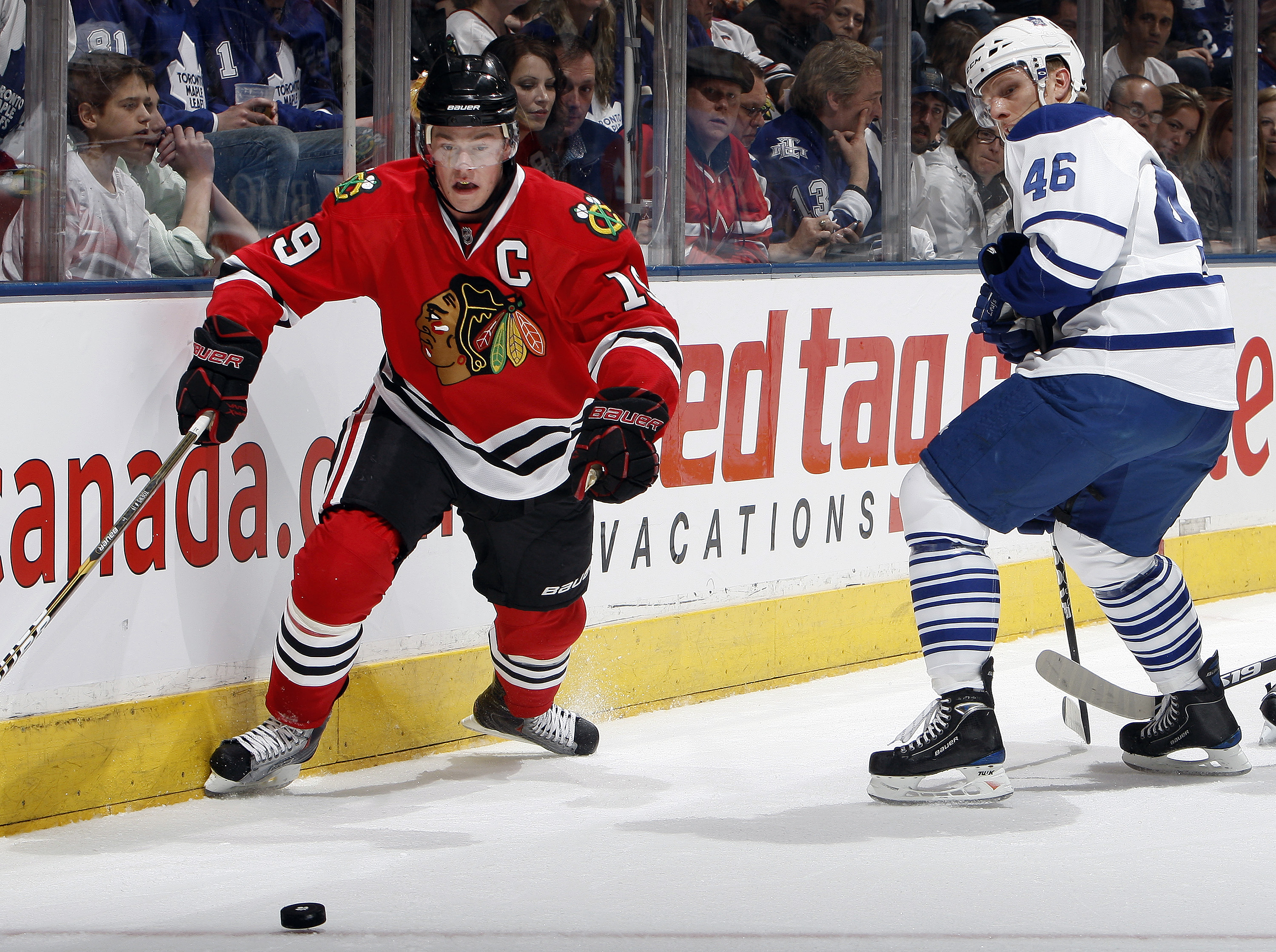 TORONTO, CANADA - MARCH 5: Joey Crabb #46 of the Toronto Maple Leafs battles for the puck against Jonathan Toews #19 of the Chicago Blackhawks during game action at the Air Canada Centre March 5, 2011 in Toronto, Ontario, Canada. (Photo by Abelimages/Gett